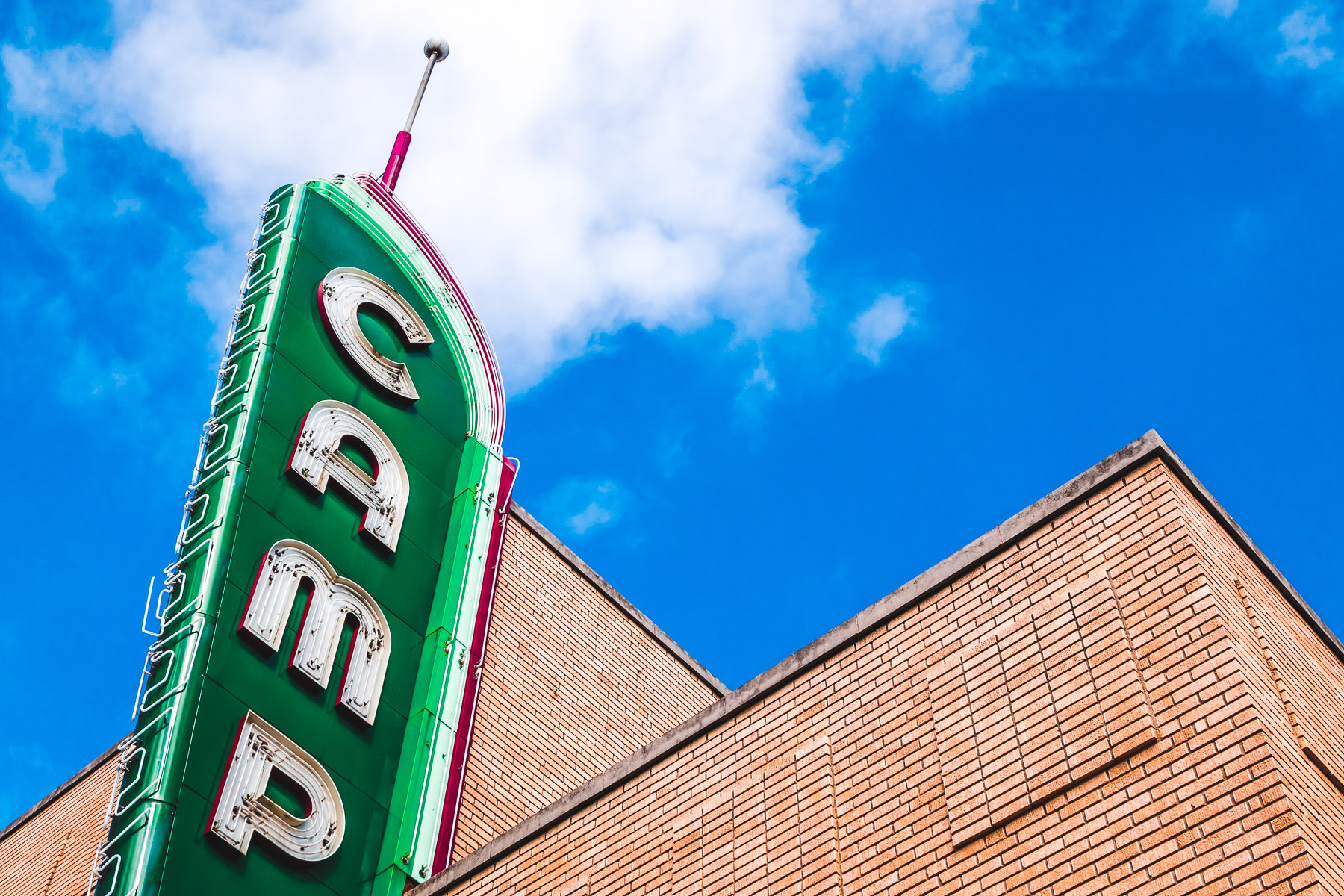 Denton, Texas' Campus Theatre's sign rises into the North Texas sky.