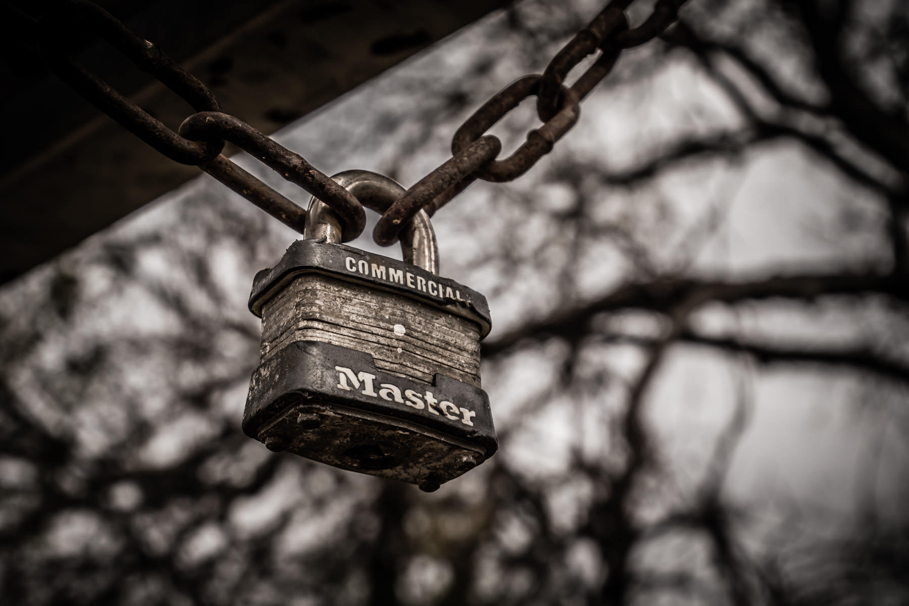 A padlock hangs from a chain in Richardson, Texas' Breckinridge Park.