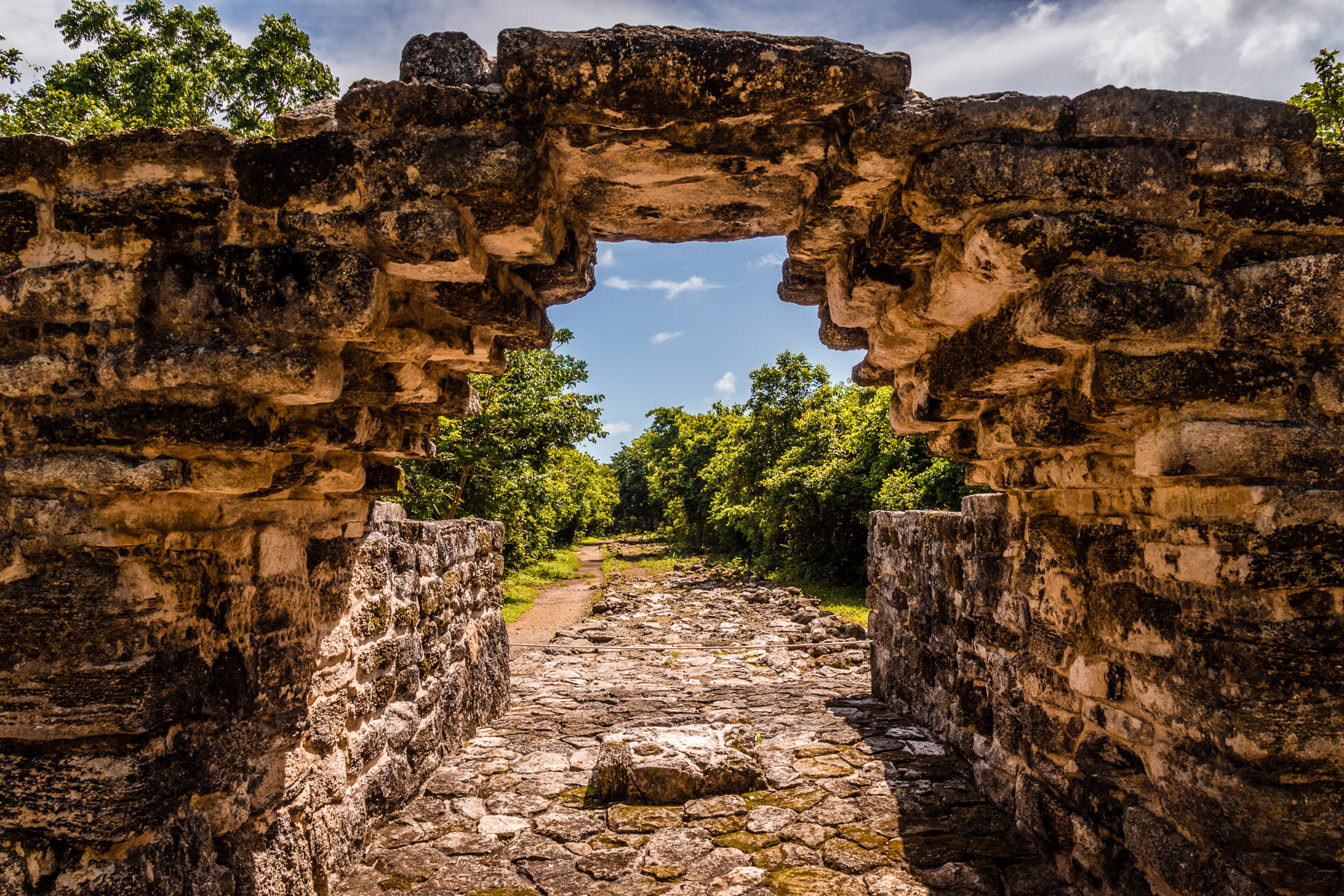 A stone arch at the pre-Columbian Mayan ruins site at San Gervasio, Cozumel, Mexico.