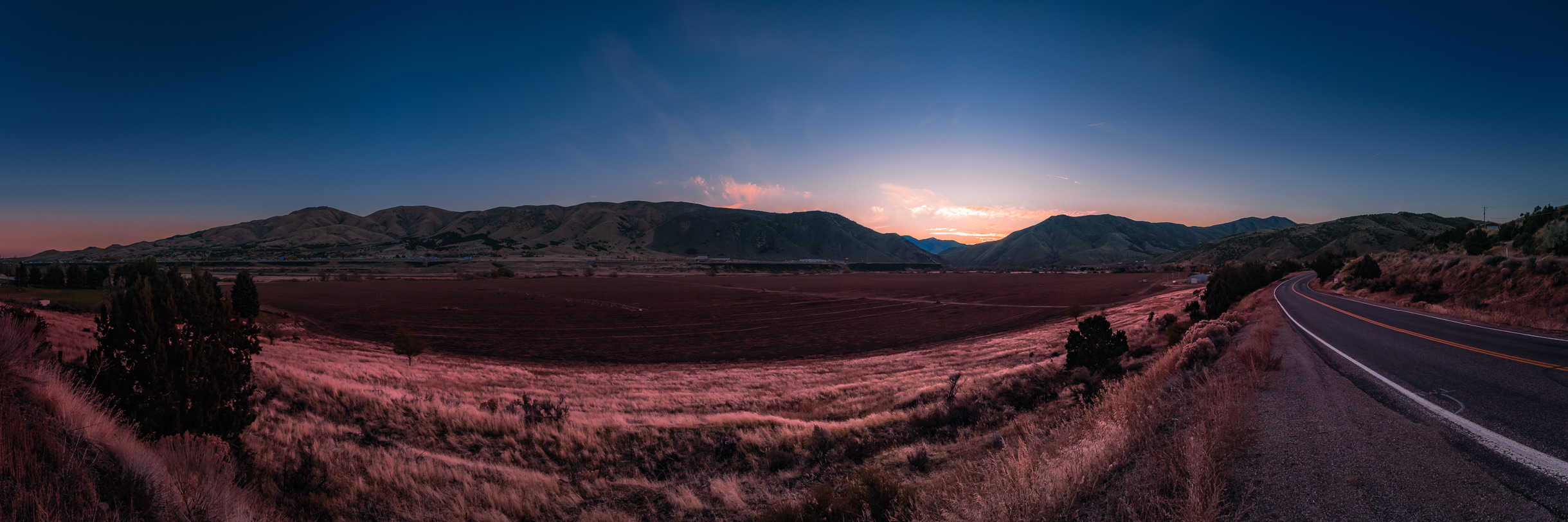 The first light of day crests the mountains on the outskirts of Pocatello, Idaho.