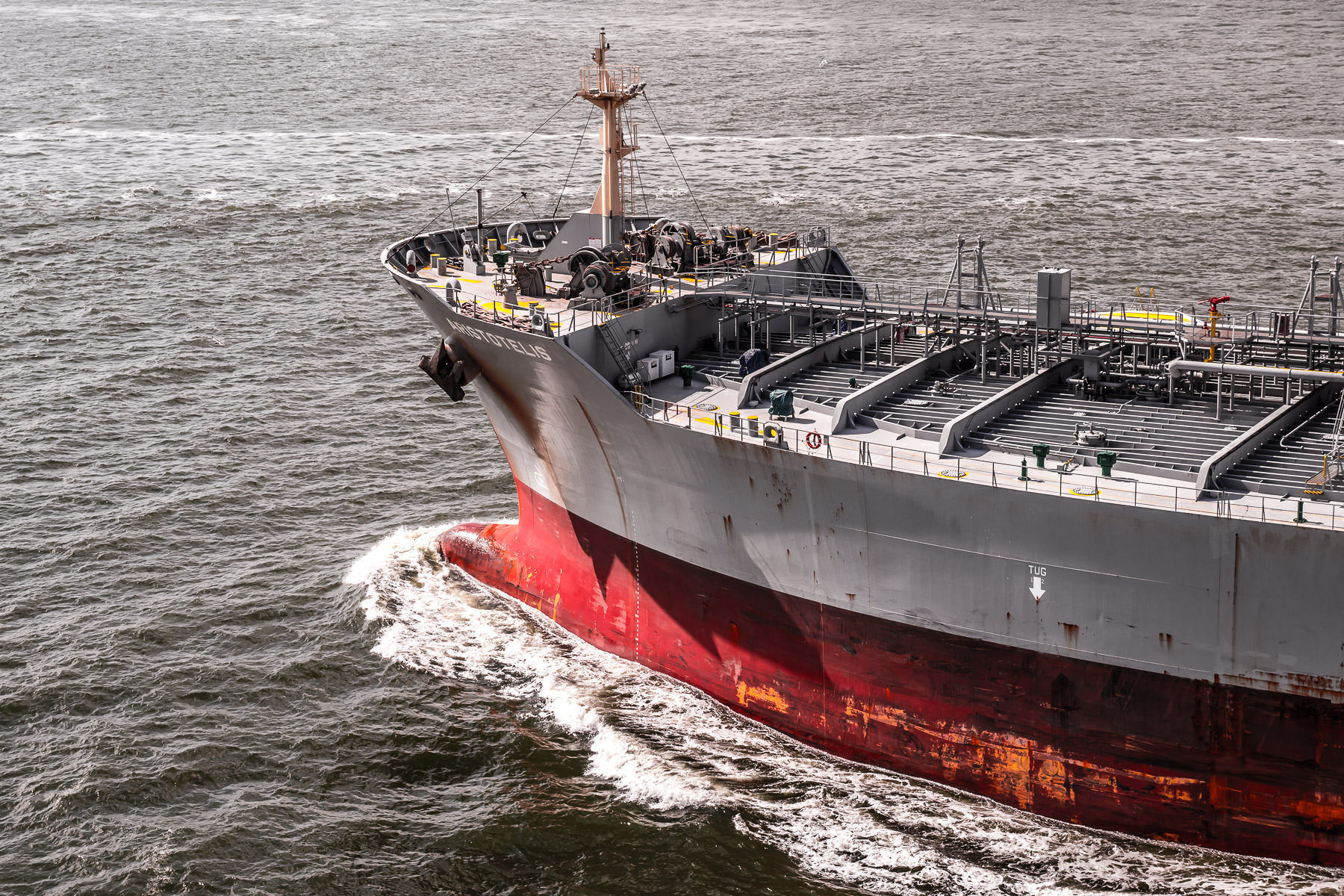 The bow of the chemical carrier Aristotelis cuts through the ocean at Bolivar Roads just off the coast of Galveston, Texas.
