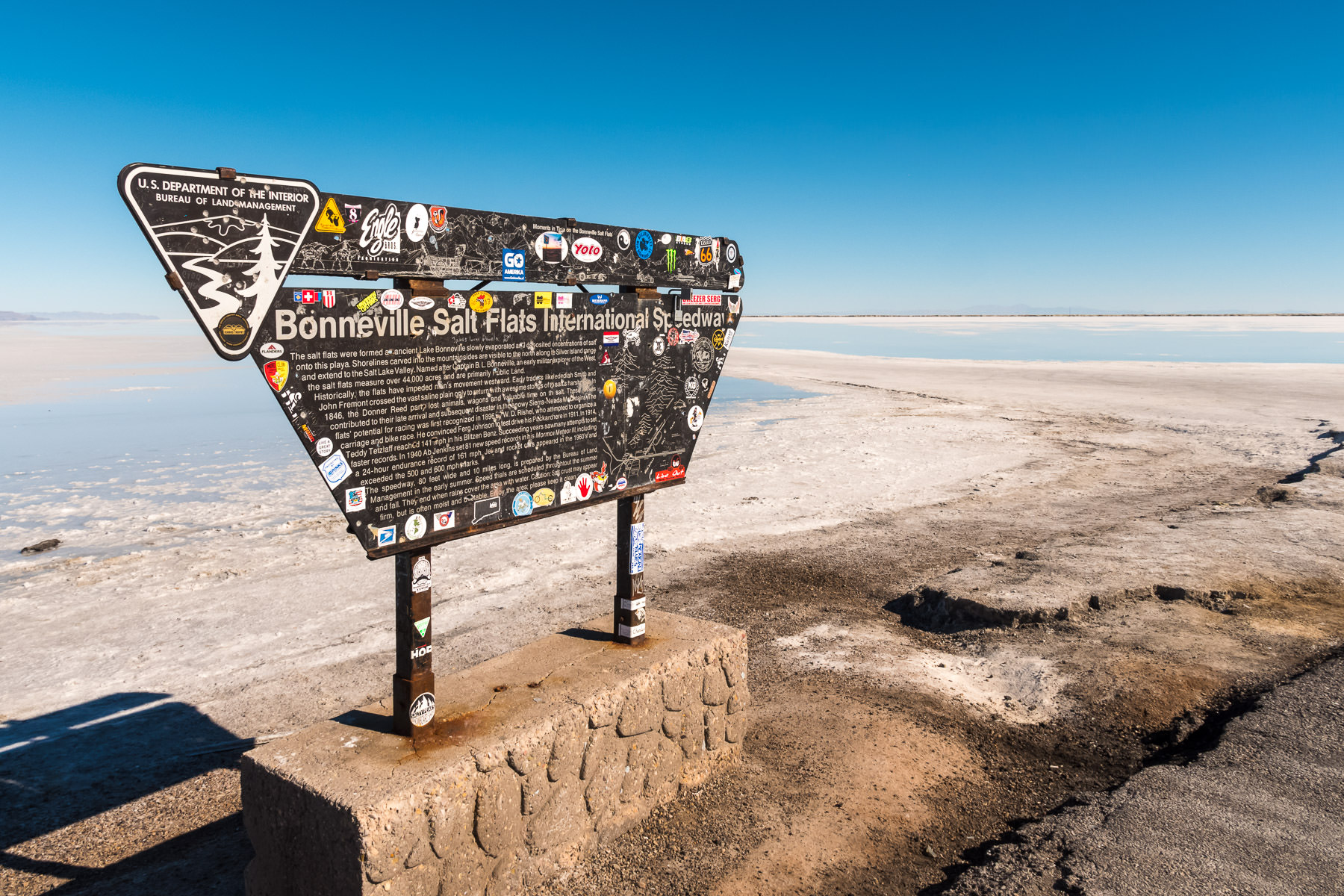 A sign at the Bonneville Salt Flats International Speedway in Utah explains the history of the site to visitors.