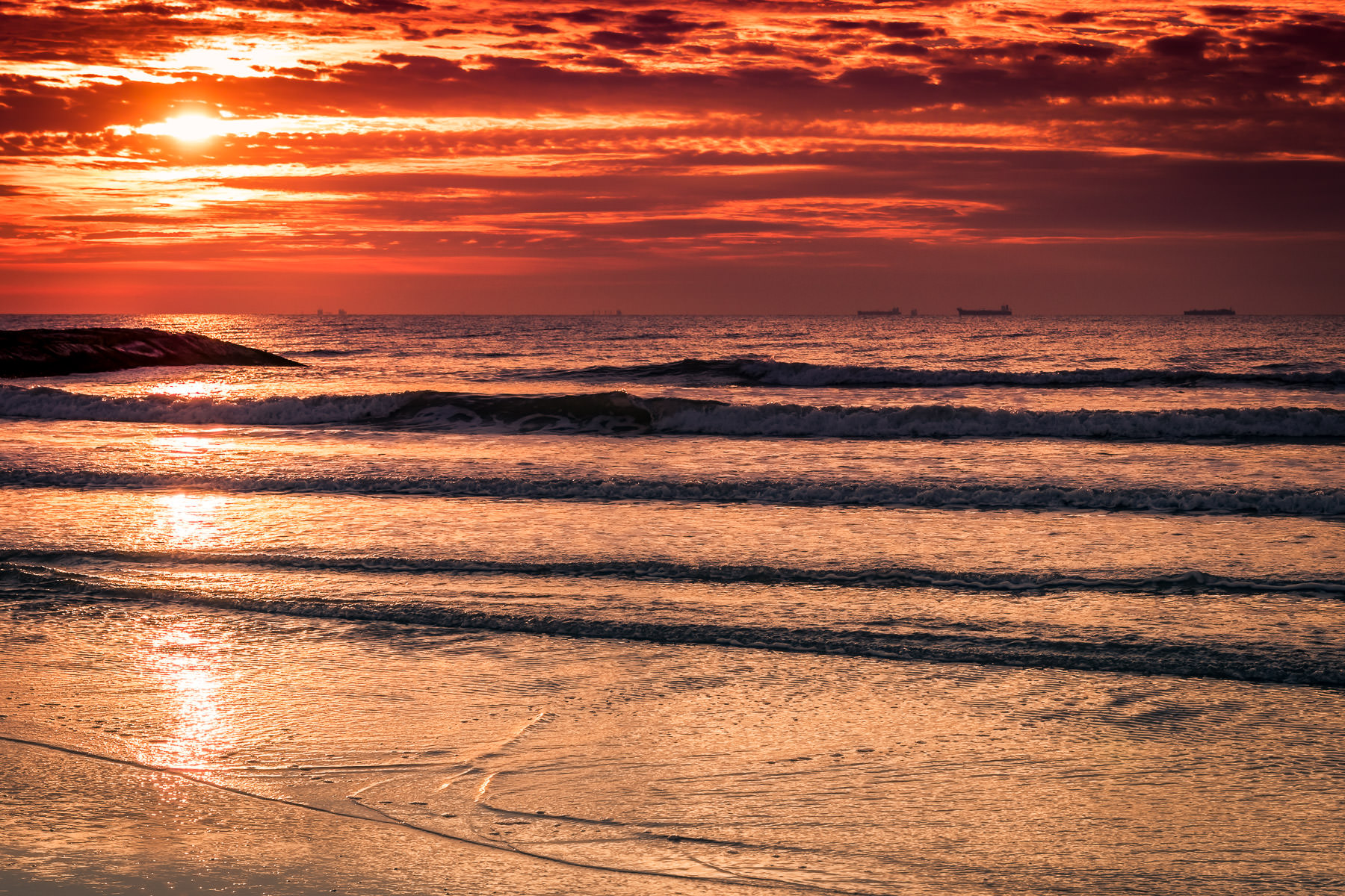 The sun rises on the Gulf of Mexico, as seen from a Galveston, Texas, beach.