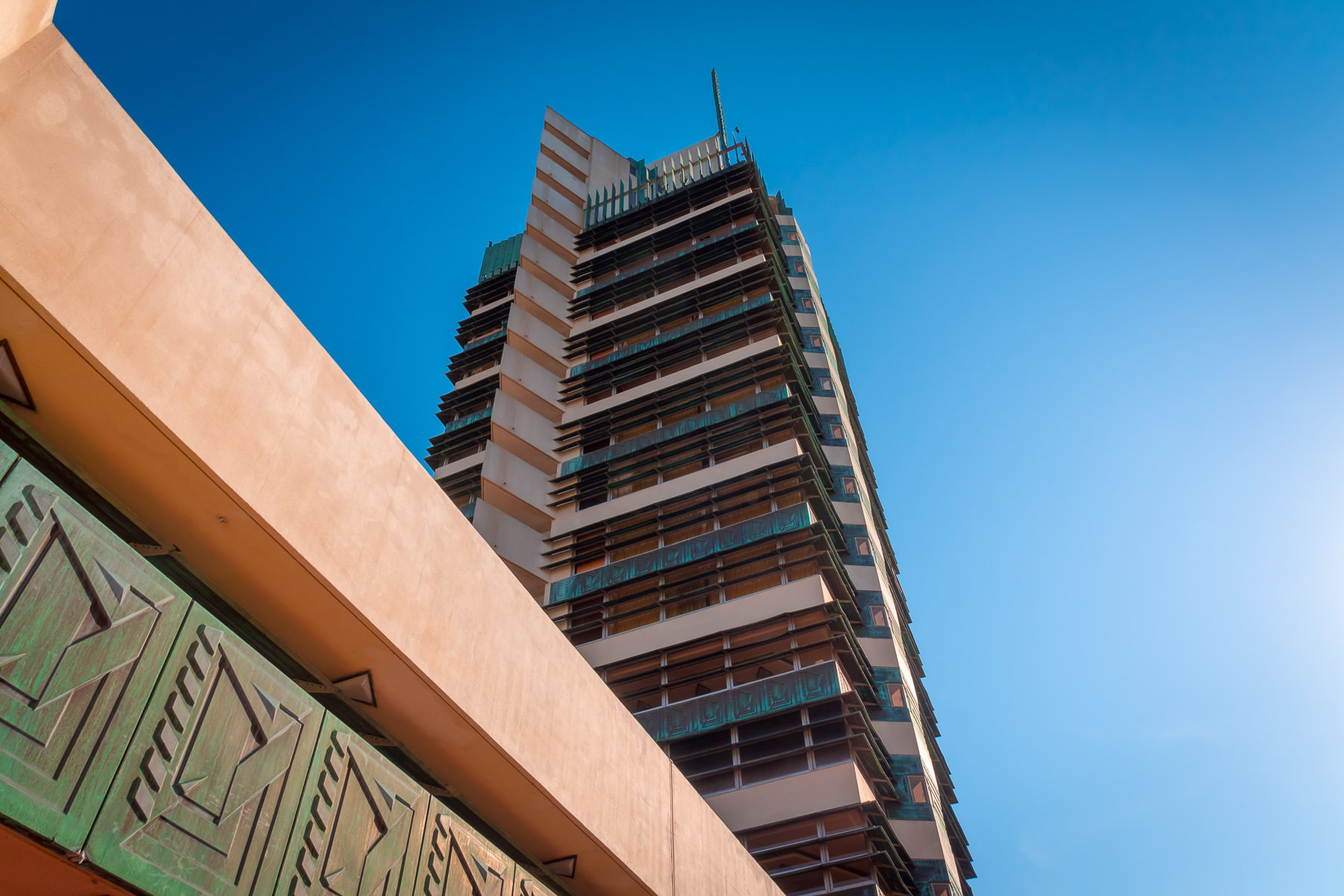 The Frank Lloyd Wright-designed Price Tower rises into the blue sky over Bartlesville, Oklahoma.