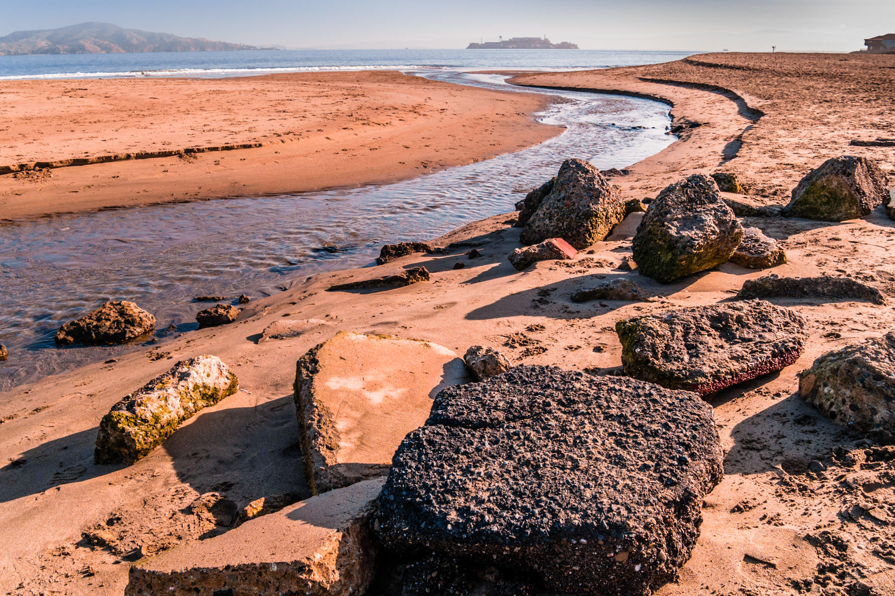 Rocks lie on the beach at Crissy Field, San Francisco.