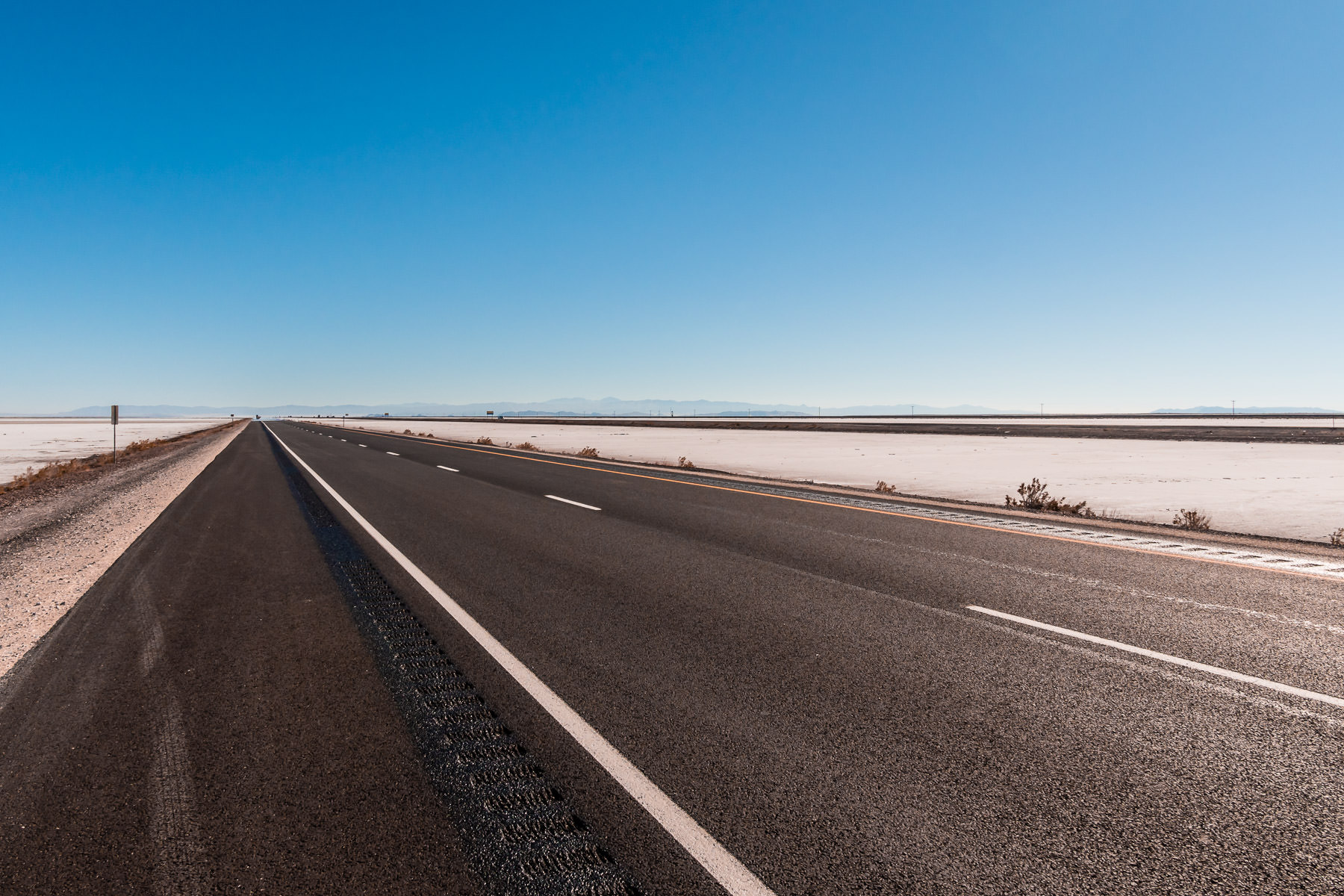 Interstate 80 traverses the arid expanse of the Bonneville Salt Flats, Utah.