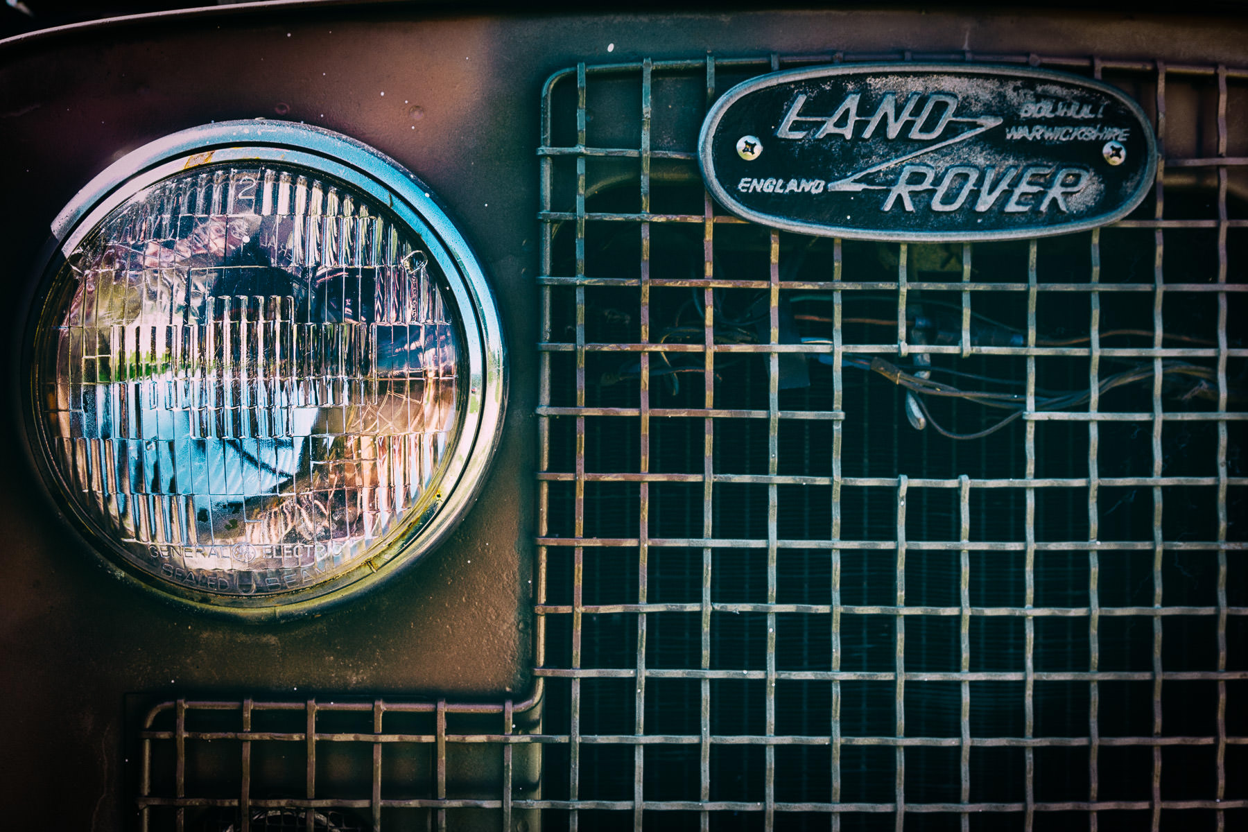 The right headlight and grill of a Land-Rover spotted at Dallas' All British and European Car Day.