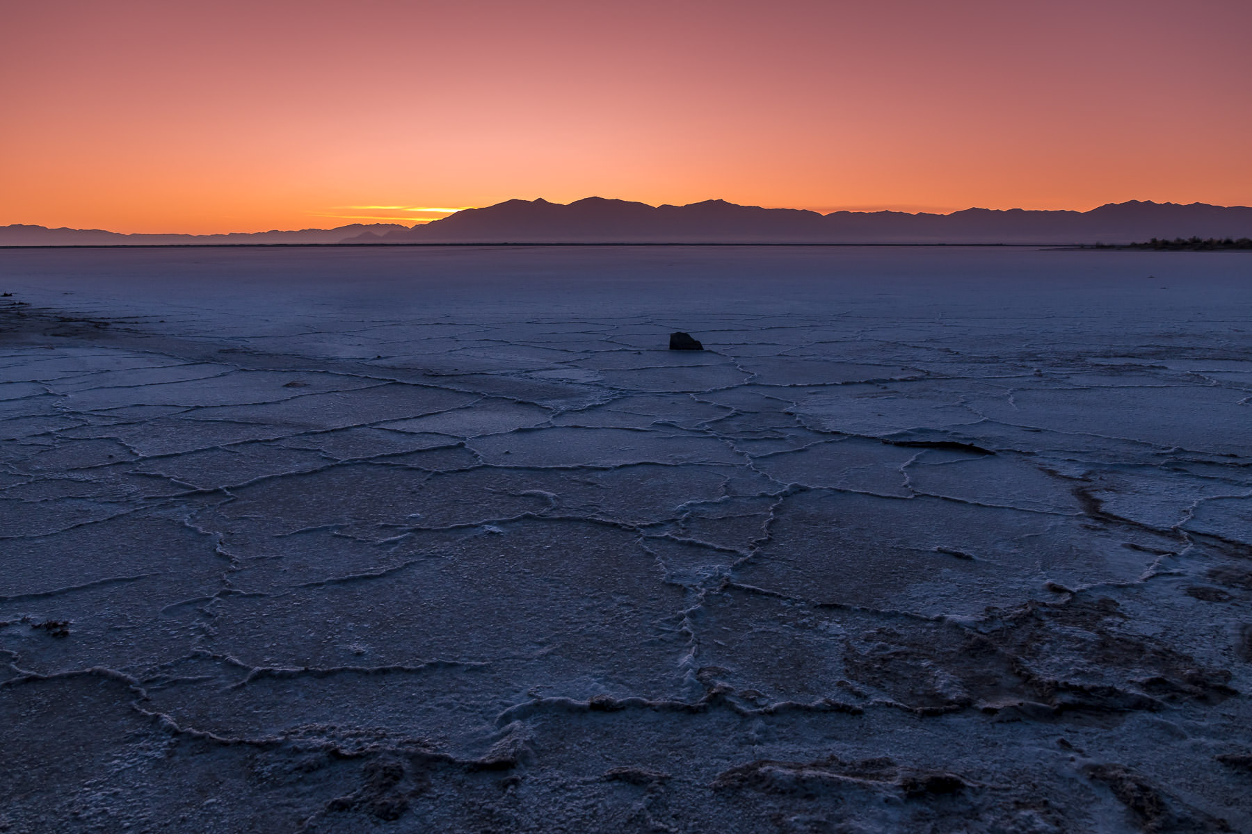 The sun rises on the dried salt flat shore of the Great Salt Lake, Utah.