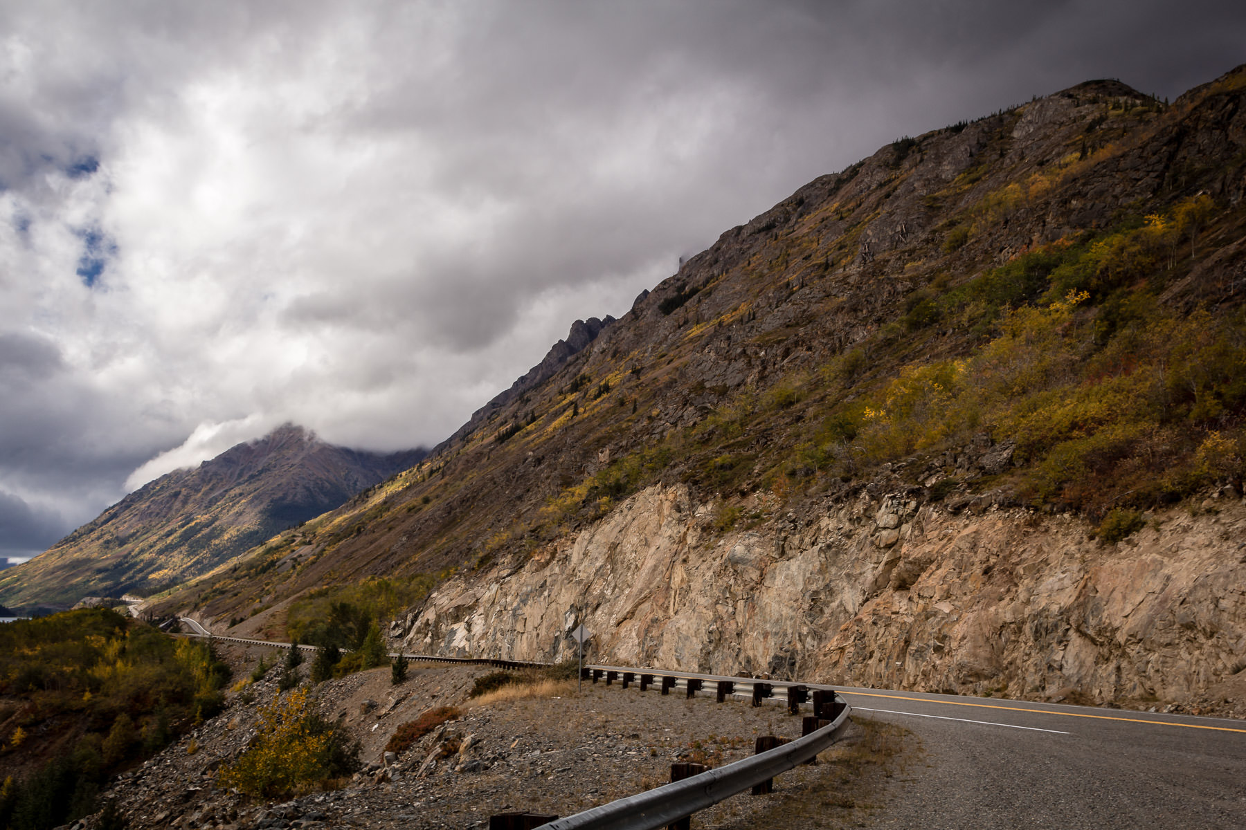 Storm clouds form over the mountains along the Klondike Highway in Canada's Yukon Territory.
