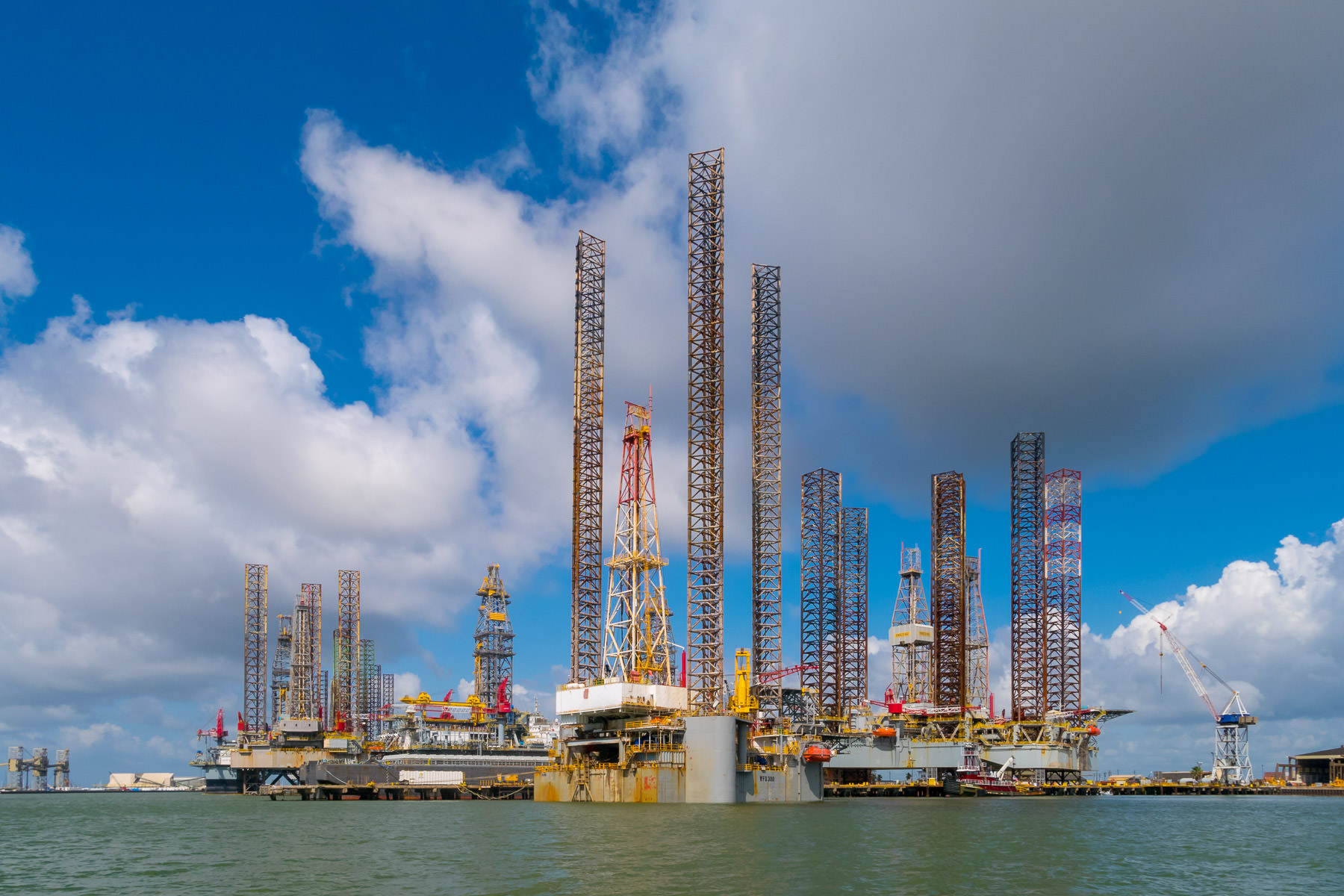 Long-legged jack-up oil platforms laid up for storage and repair at Pelican Island, Galveston, Texas.