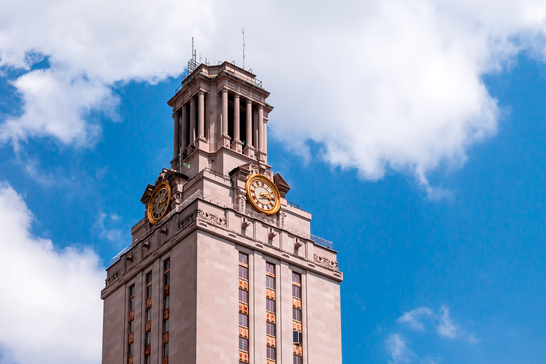 The 307-foot-tall Main Building at the University of Texas at Austin rises into the cloudy Texas sky.