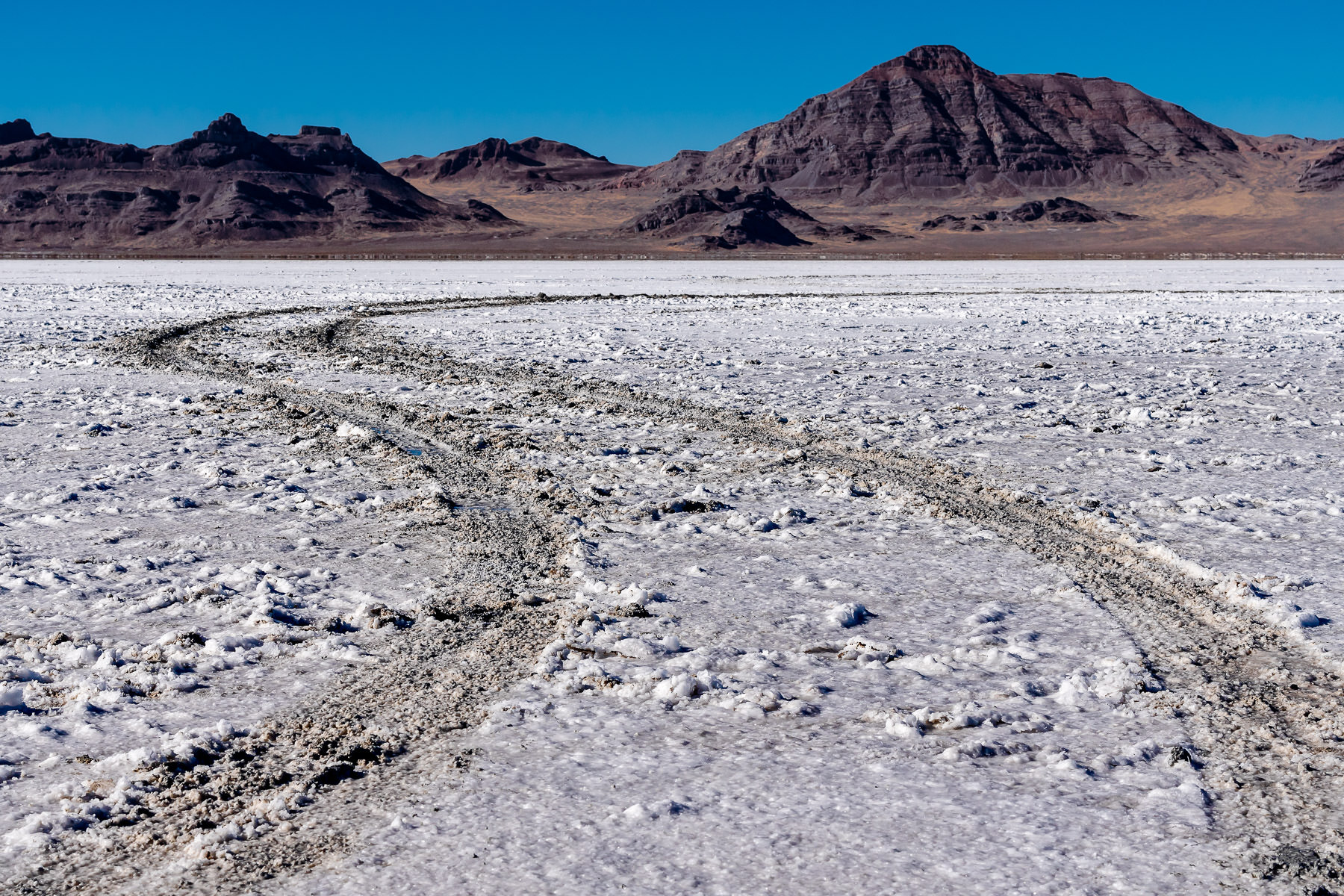 Tire tracks mar the surface of Utah's Bonneville Salt Flats.