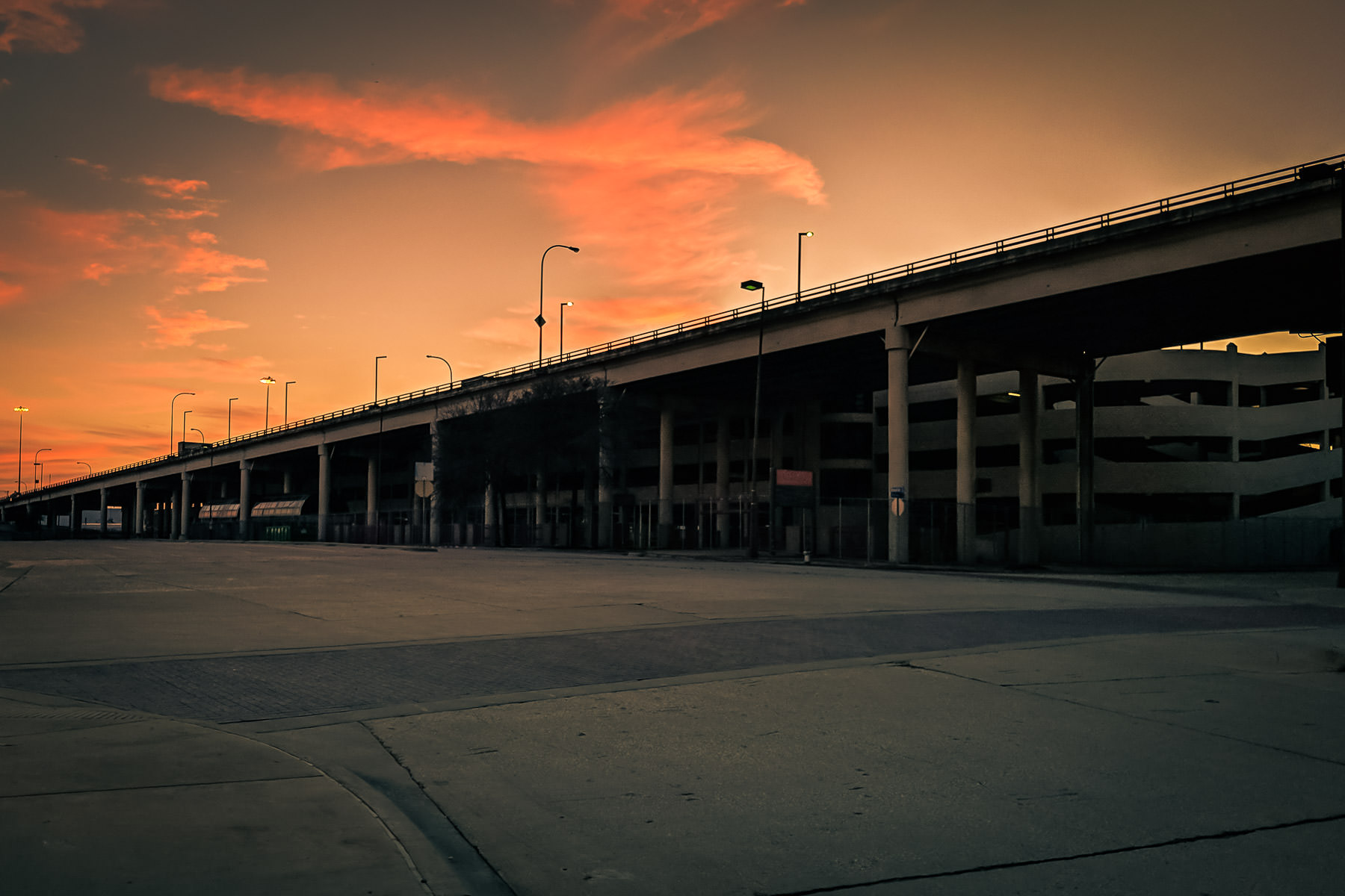 Dallas' Jefferson Boulevard Viaduct is silhouetted by the last light of day on the west end of downtown.