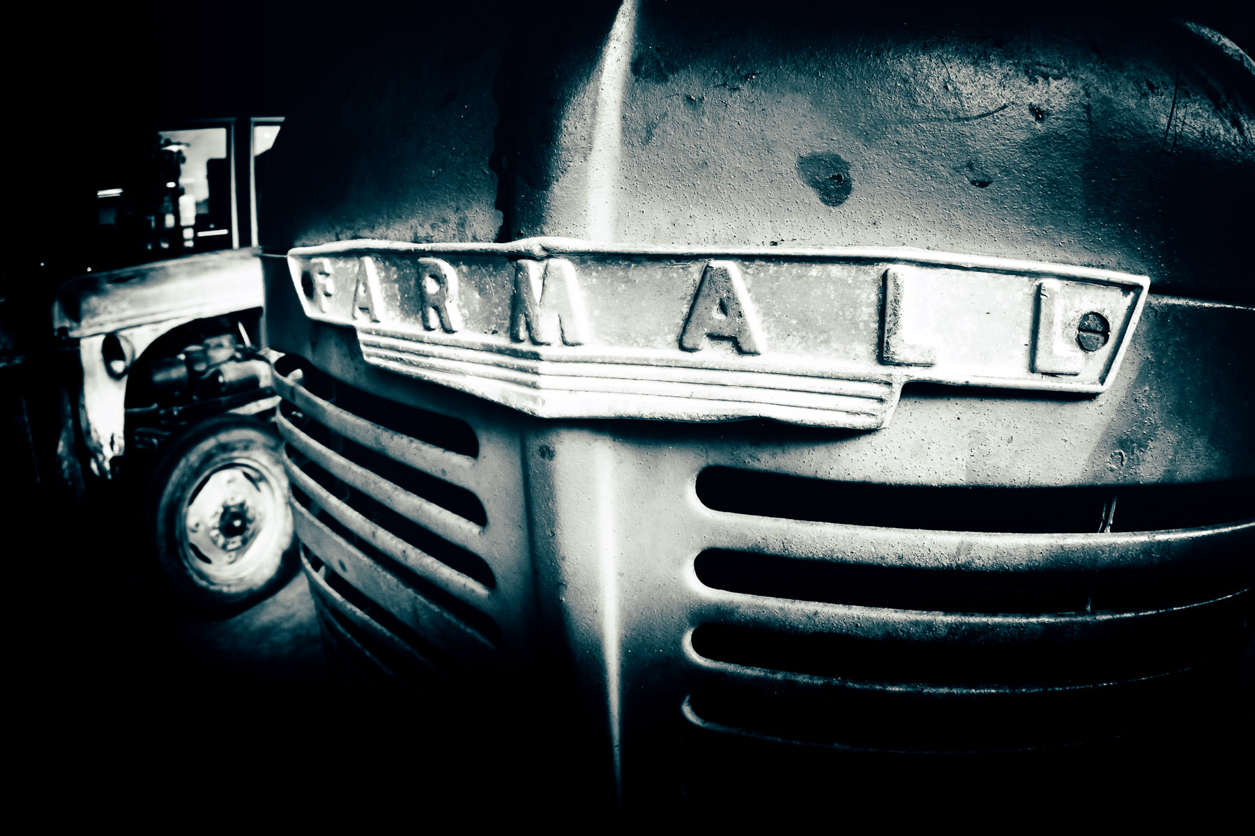 Detail of an old International Harvester Farmall tractor, spotted in Downtown McKinney, Texas.