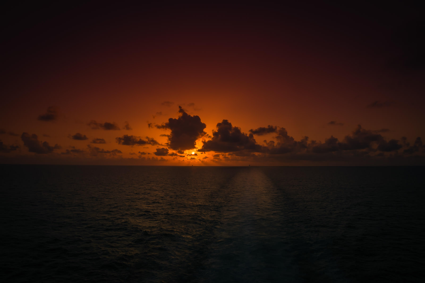 The sun sets on the Gulf of Mexico, somewhere off the Texas coast.