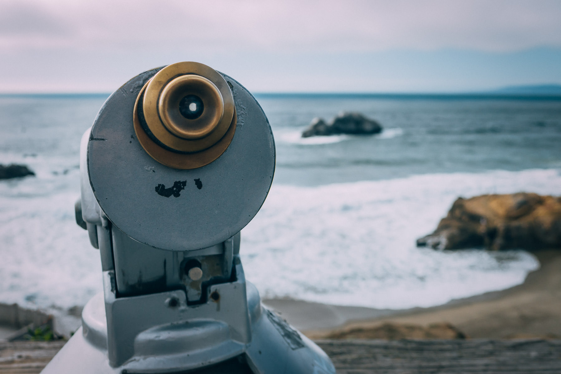 A coin-operated telescope overlooks Seal Rocks at San Francisco's Lands End.