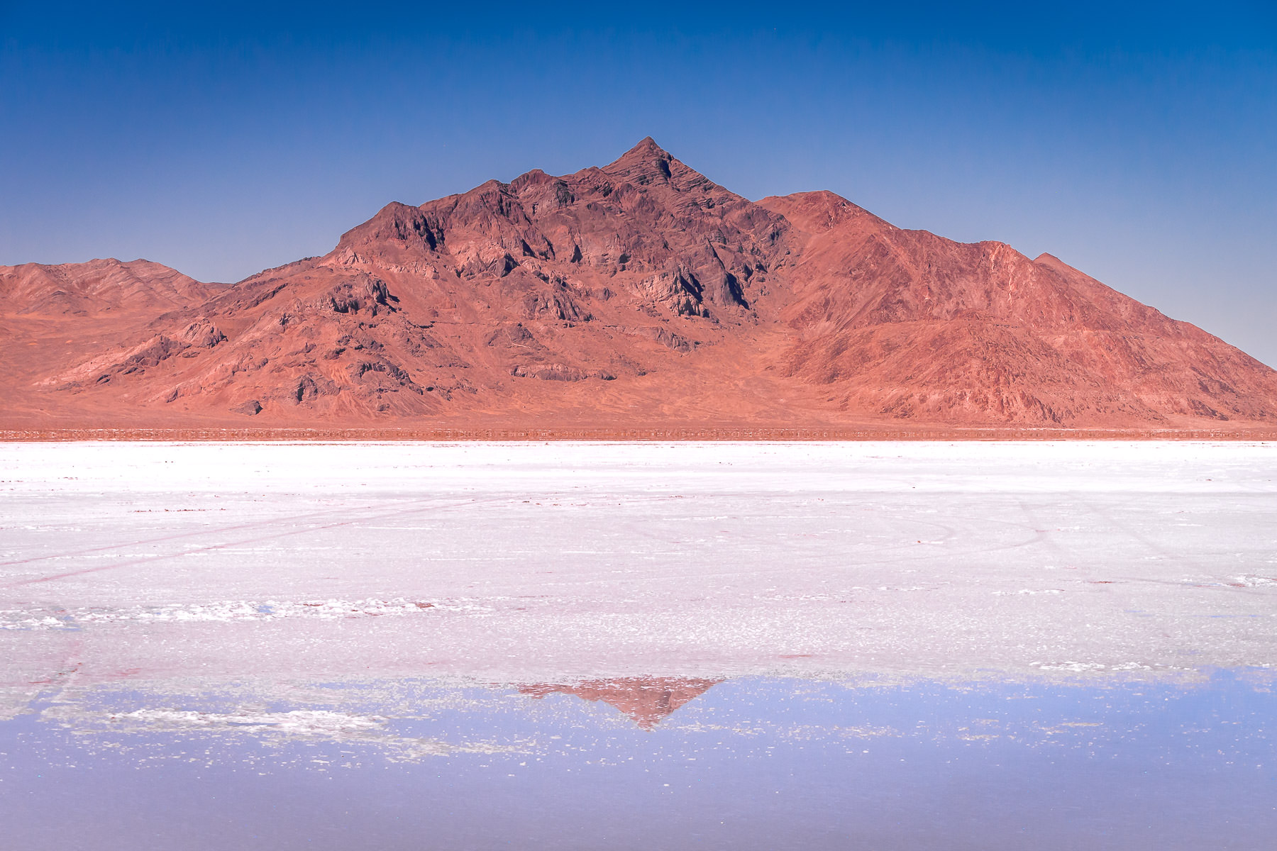Mountains rise above the desolate Bonneville Salt Flats, Utah.