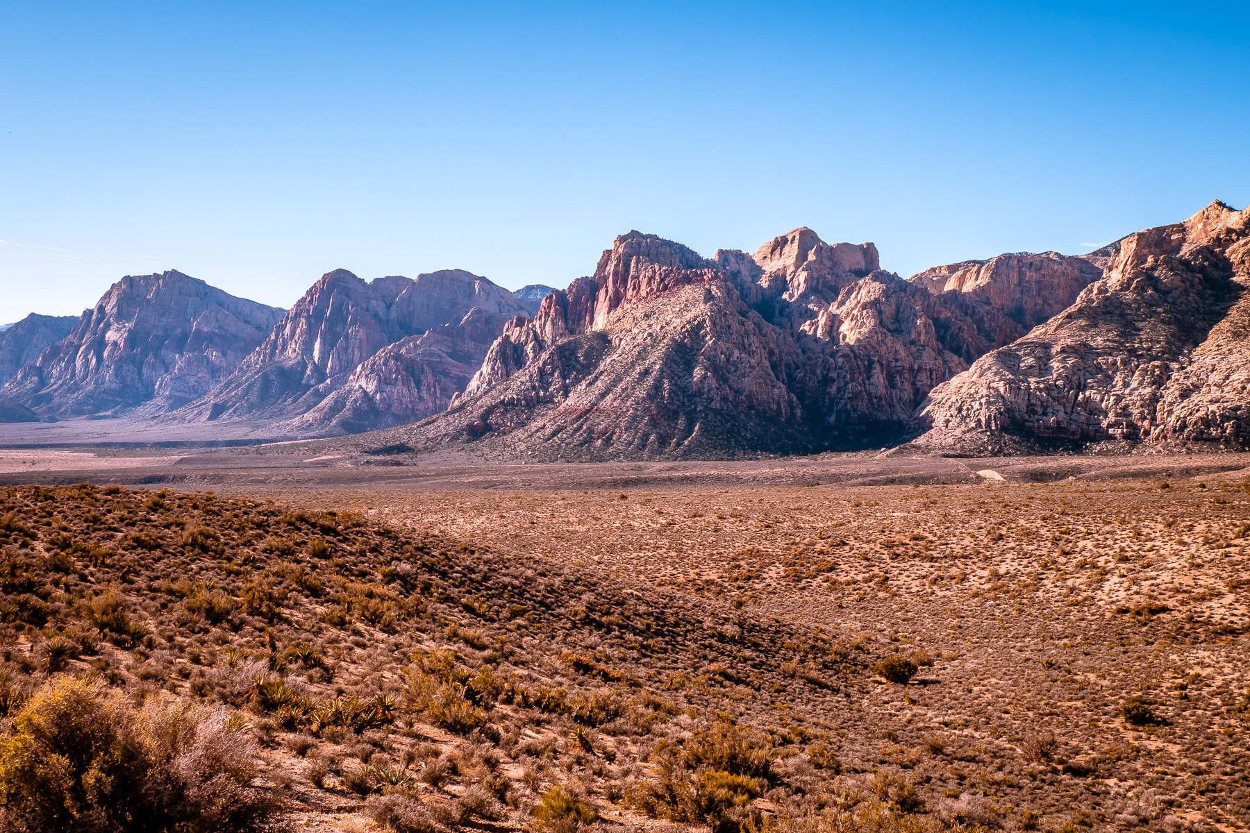 A mountain range stretches into the distance at Nevada's Red Rock Canyon.