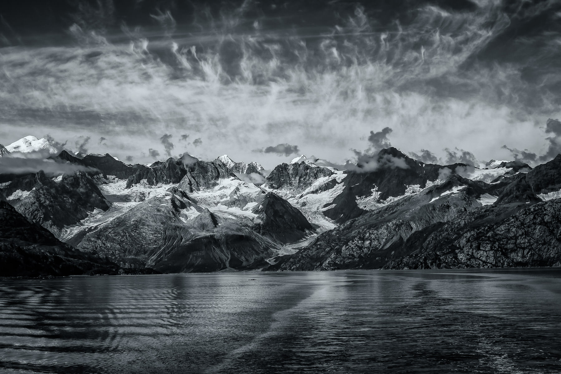 Mountains dramatically rise along the coastline of Alaska's Glacier Bay.