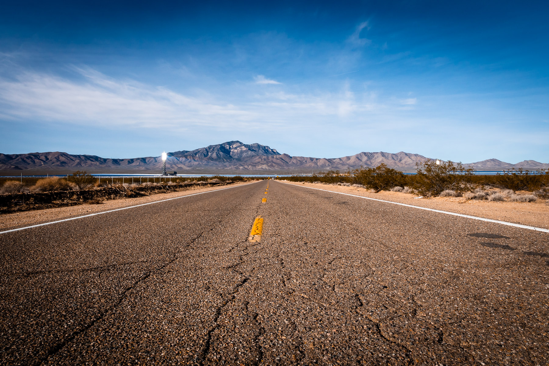 A lonely road leads to the Ivanpah Solar Power Facility in the California desert near the Nevada border.