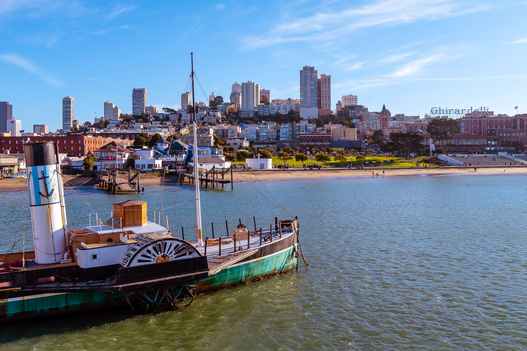 San Francisco's Russian Hill rises over the 1914 paddlewheel tugboat Eppleton Hall at the San Francisco Maritime National Historical Park.