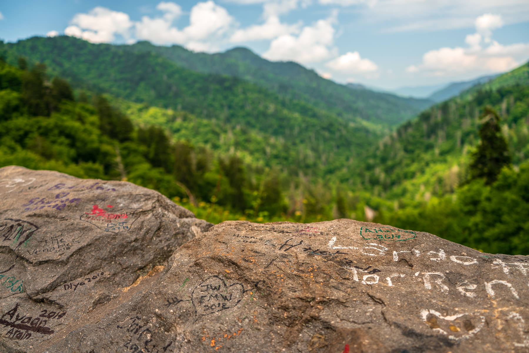 Graffiti-adorned rocks make up part of a retaining wall at a scenic overlook in Tennessee's Great Smoky Mountains National Park.