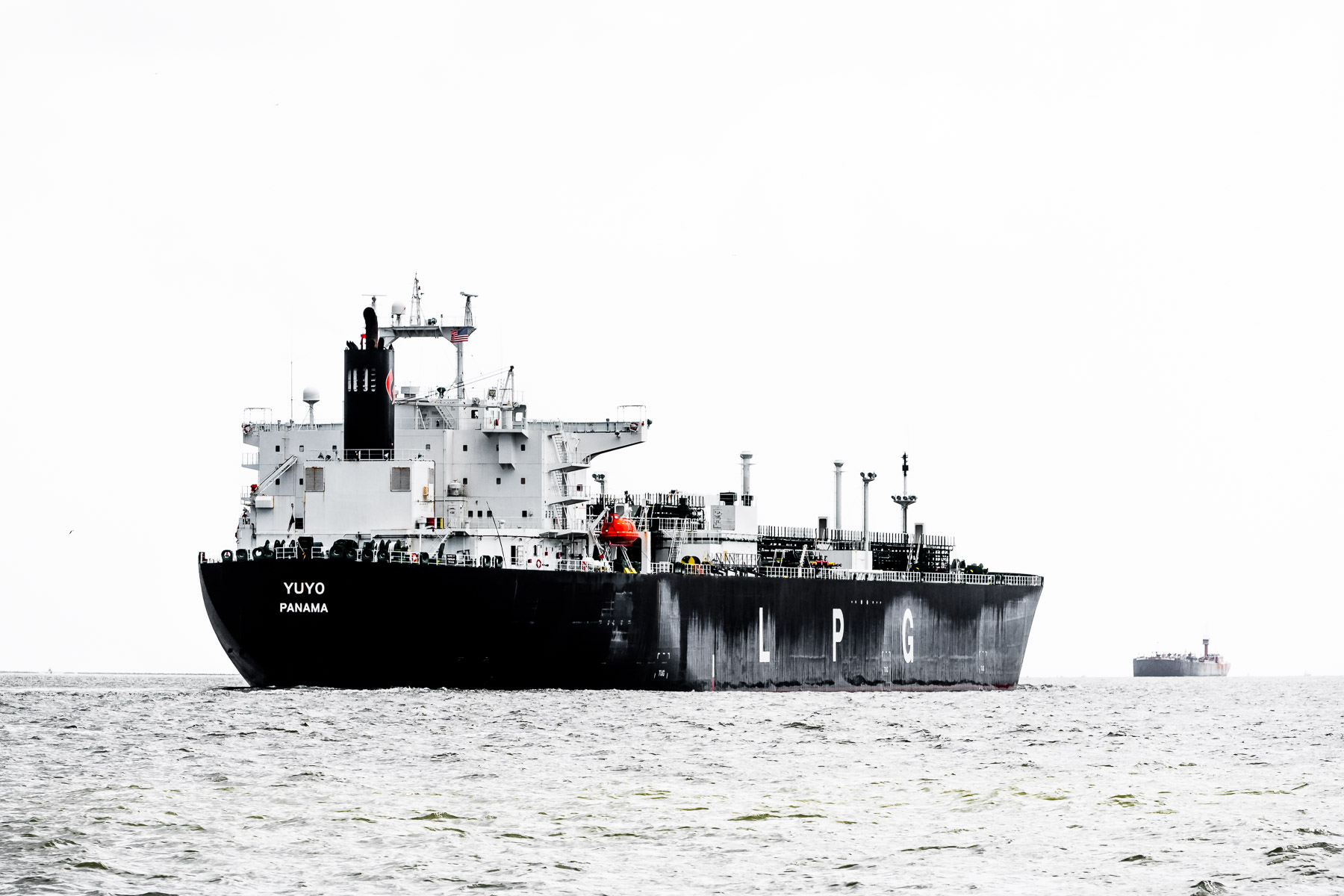 The liquefied petroleum gas tanker Yuyo transits Bolivar Roads off the coast of Galveston, Texas.