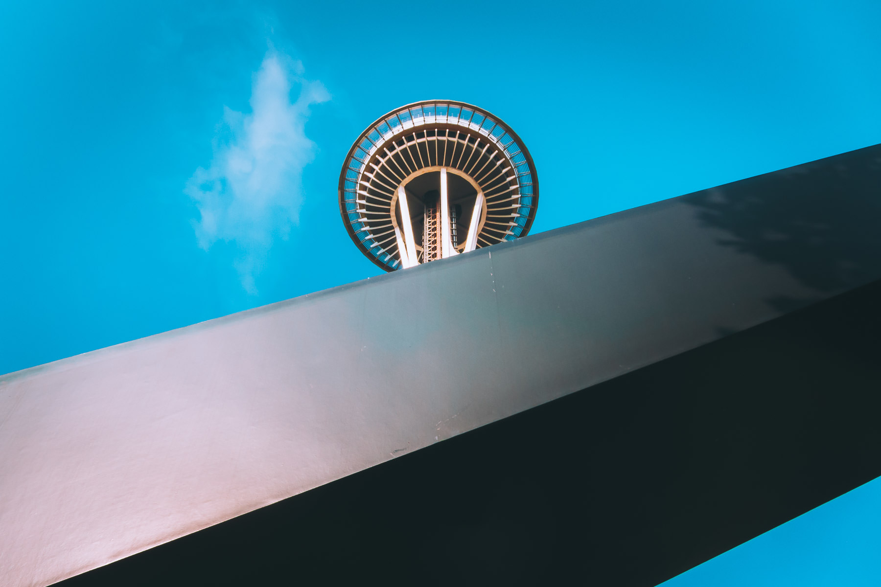 The Seattle Space Needle rises over part of a nearby sculpture.
