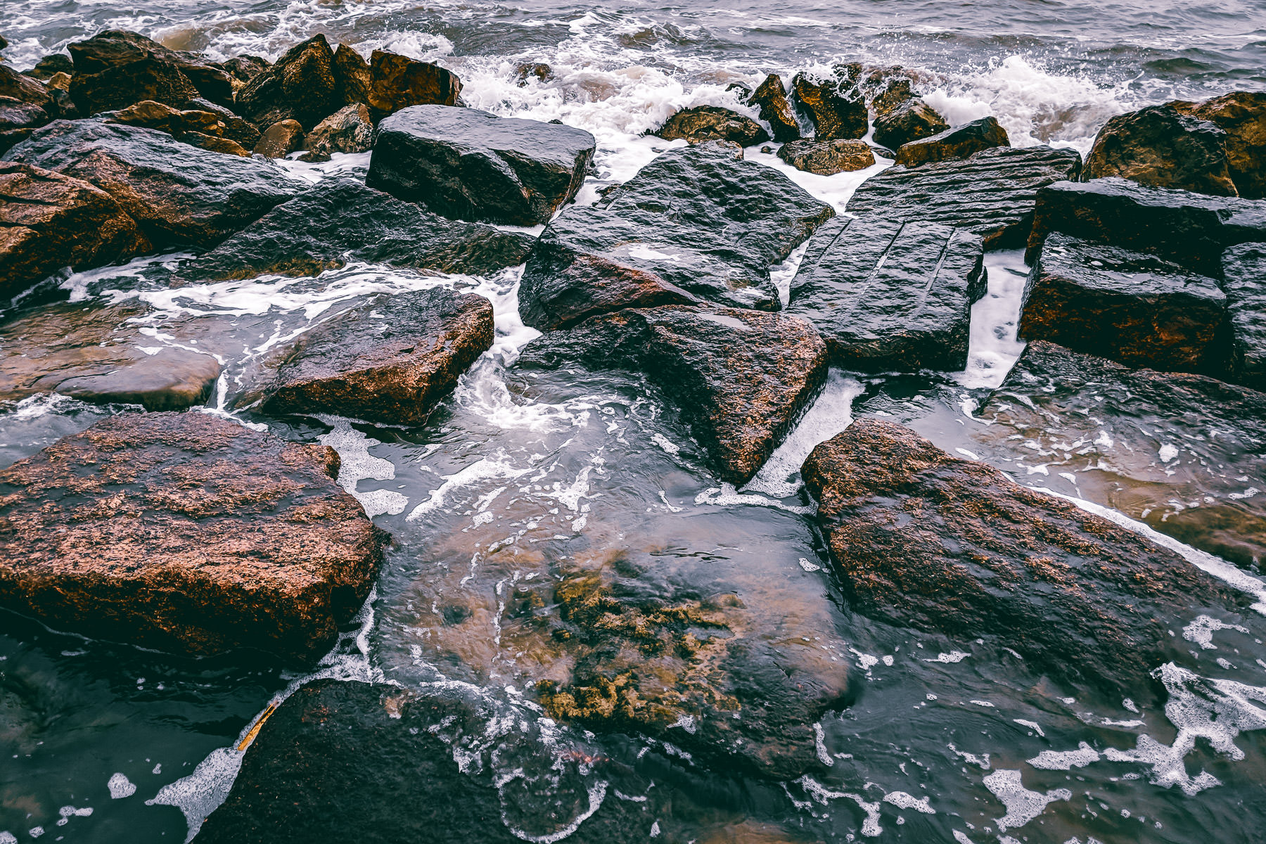 Granite blocks along the Galveston, Texas, seawall absorb the pounding surf of the Gulf of Mexico.