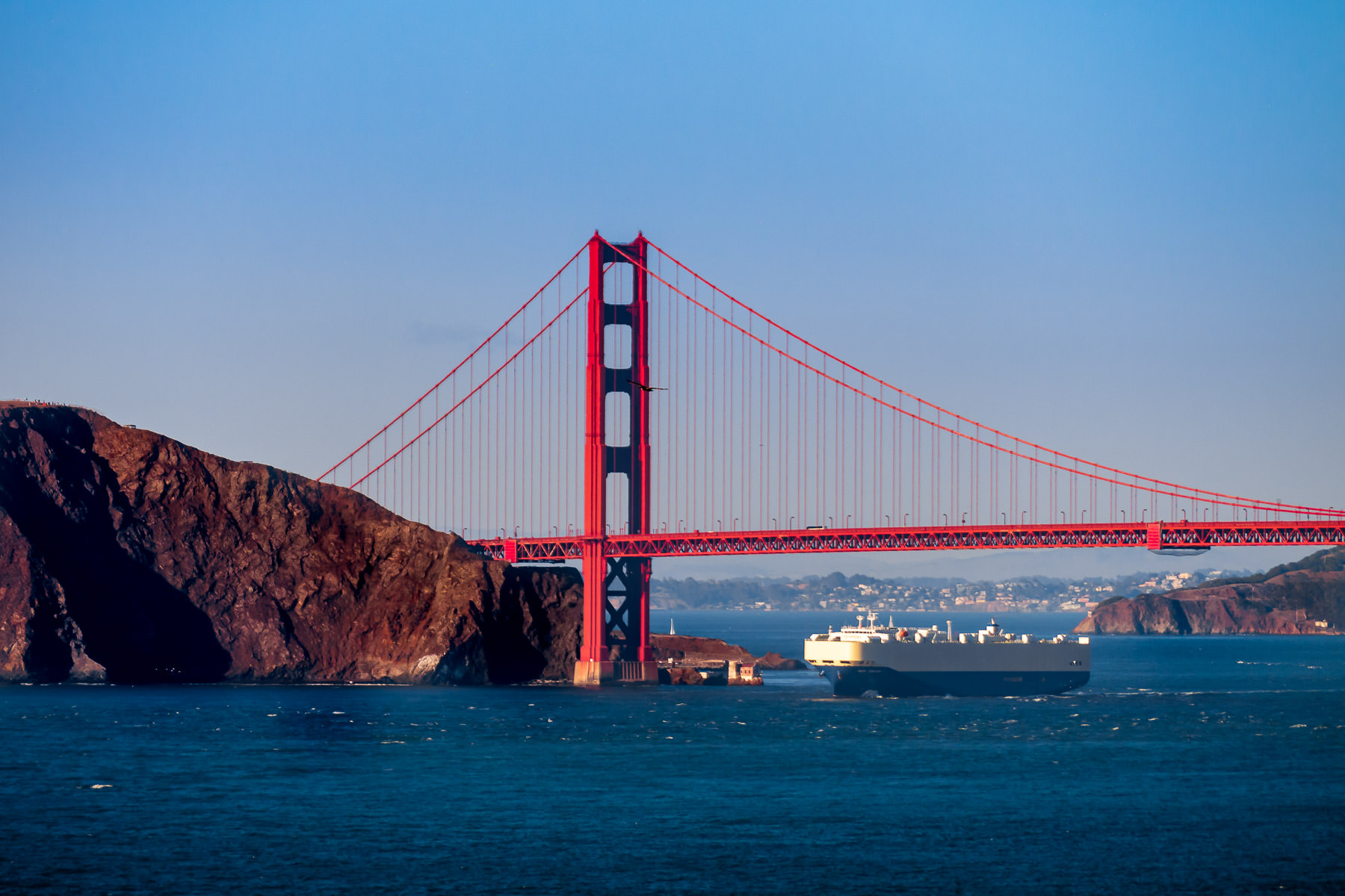 A roll-on/roll-off ship sails underneath the Golden Gate Bridge as it enters San Francisco Bay.