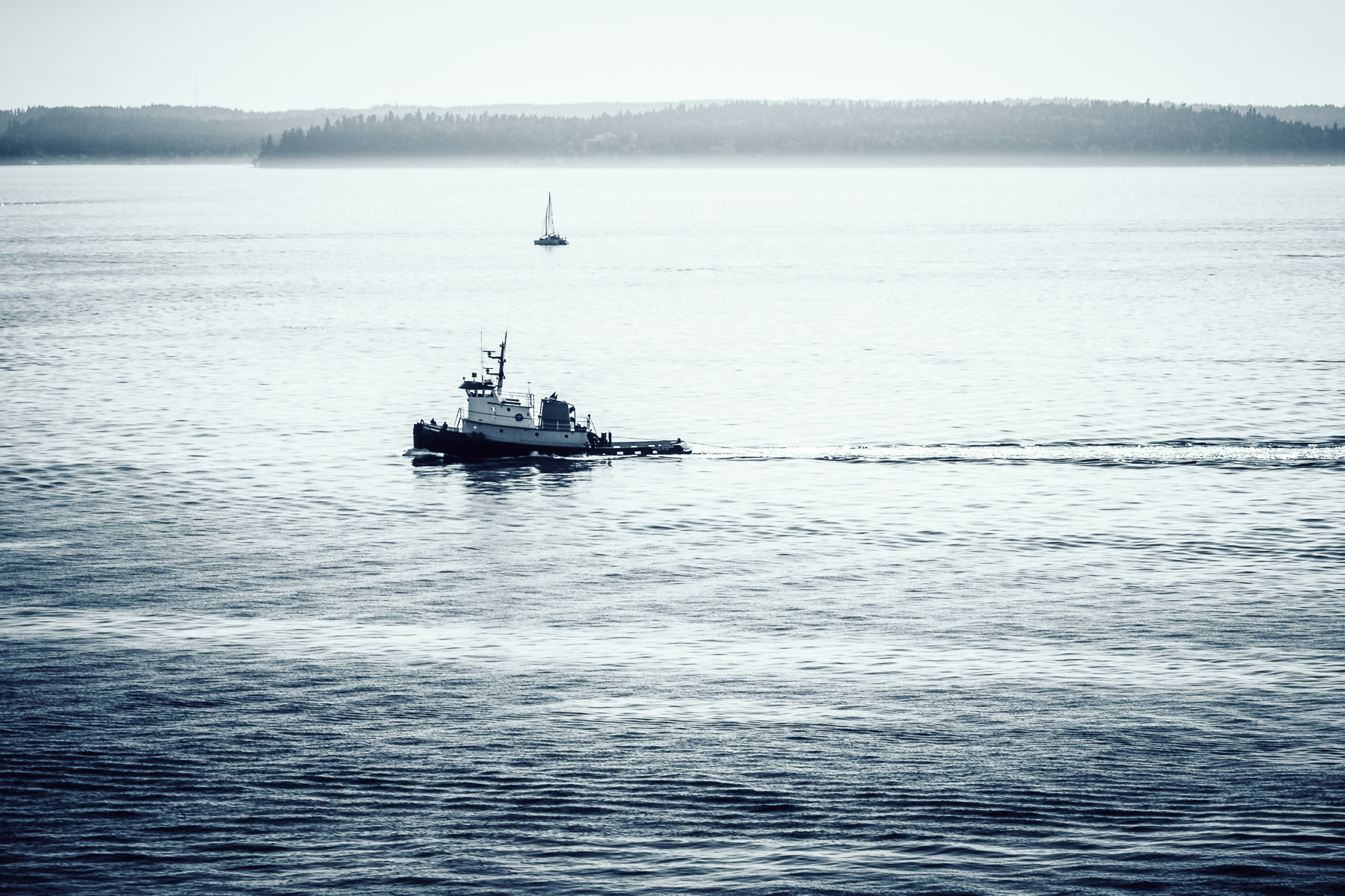 A boat motors through the waters of Washington's Puget Sound near Seattle.