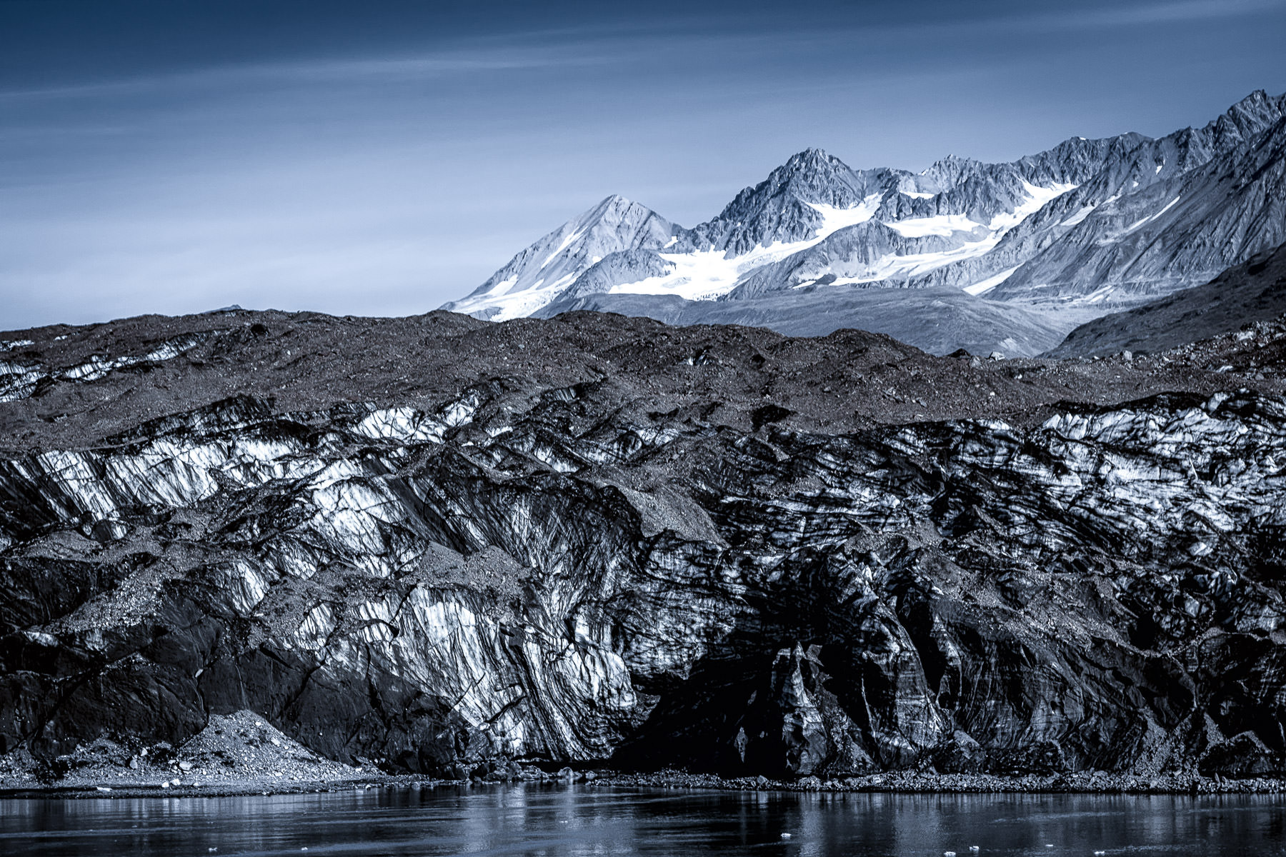 Mountains rise along the shore of Alaska's Glacier Bay.