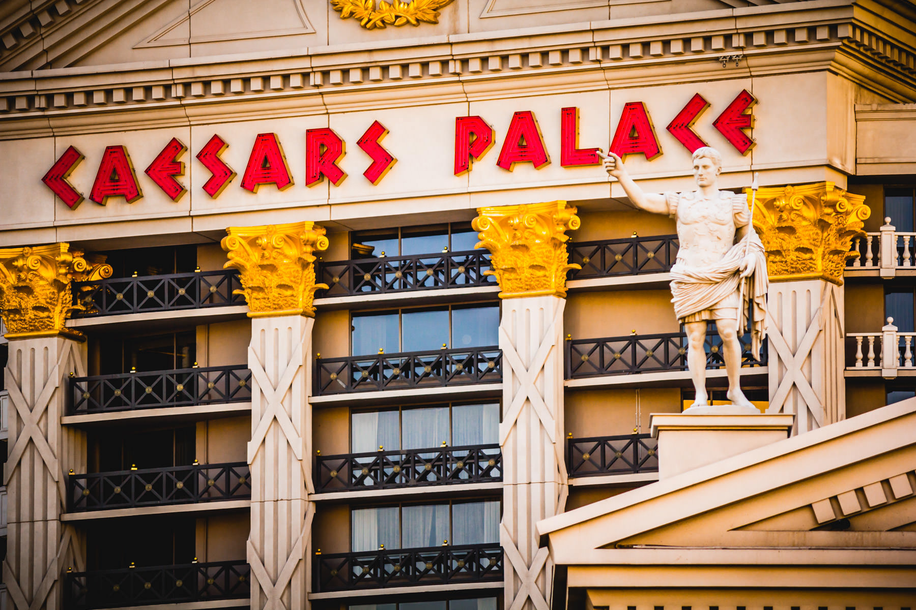 A statue outside of Las Vegas' Caesars Palace seems to point at the resort's sign on one of its guest room towers.