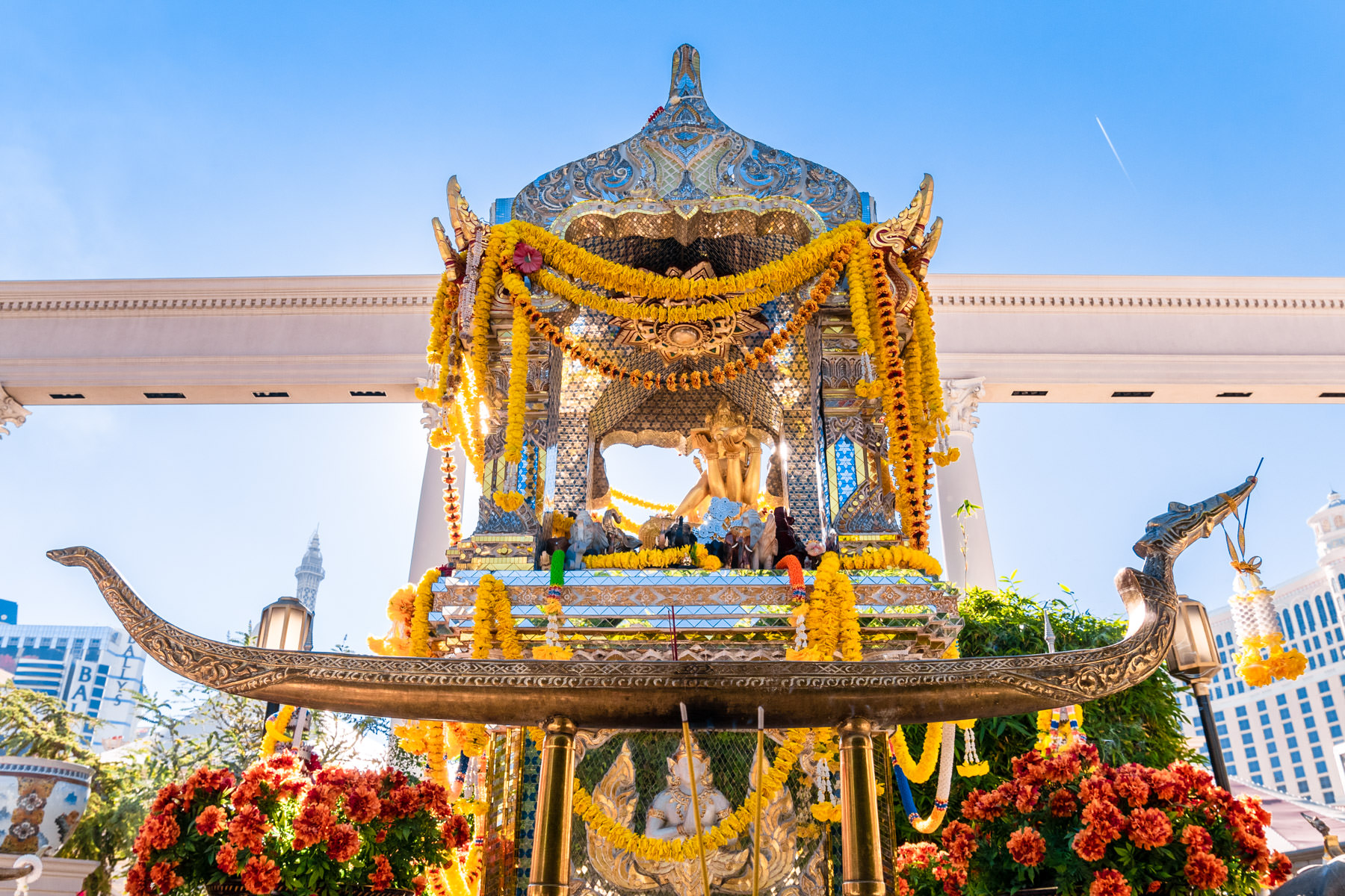 The Erawan Shrine (or Shrine of the Four-Faced Brahma) at Caesars Palace, Las Vegas, was built in 1984 and is a replica of the original in Bangkok, Thailand. It was donated by newspaper tycoons Mr. and Mrs. Kamphol Vacharaphol and Mr. Yip Hon, a prominent figure in Hong Kong and is considered a Hindu holy site. Visitors express gratitude for wishes granted by offering flowers, incense, money (which Caesars donates to charities in Thailand) or by placing small wooden elephants upon the shrine.