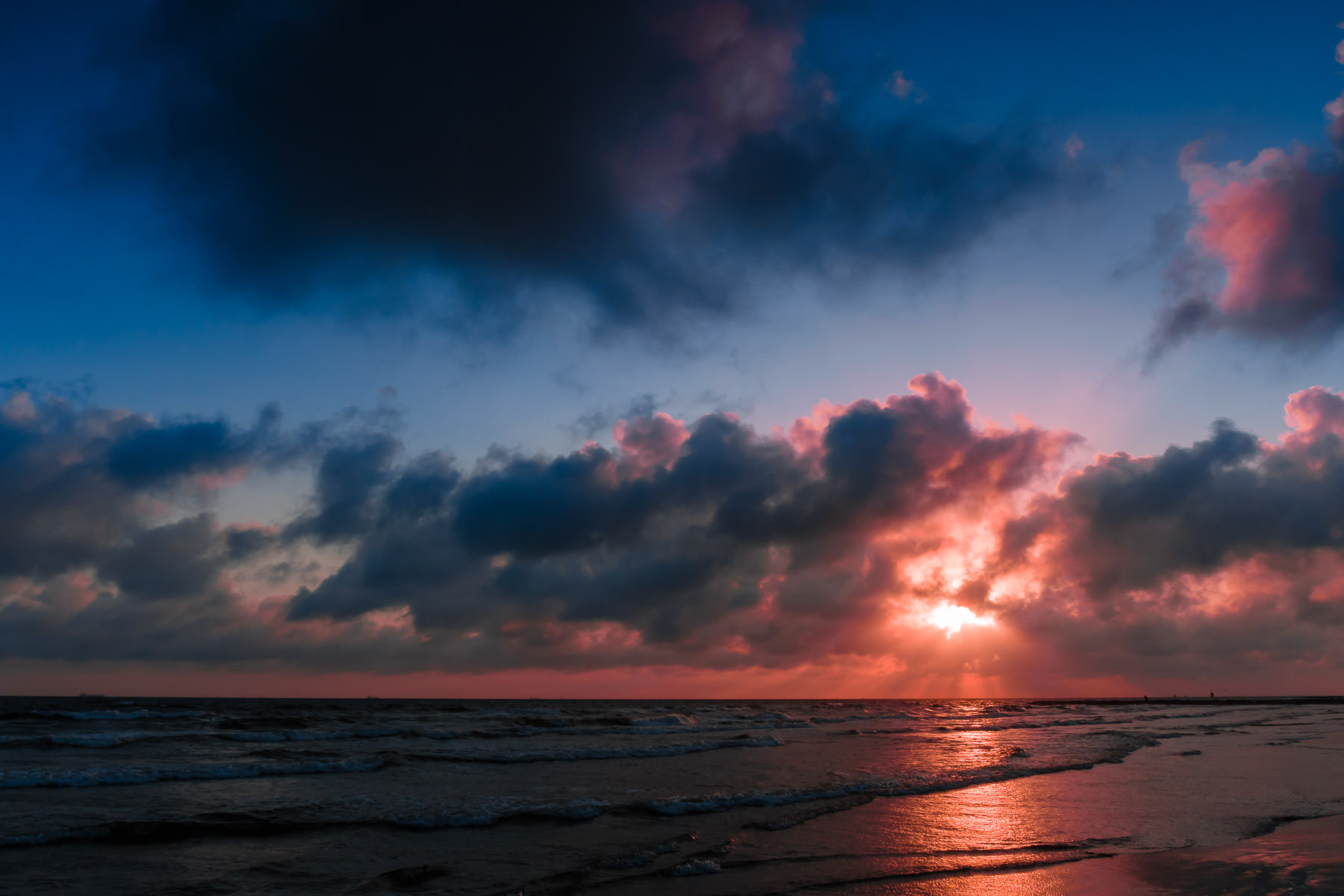 The sun rises on a Galveston, Texas, beach.