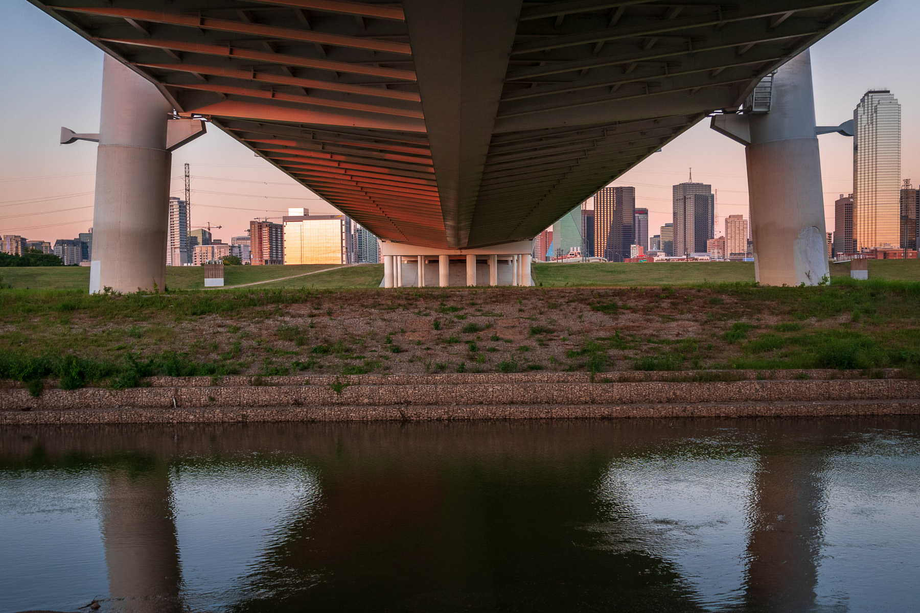 The Margaret Hunt Hill Bridge reaches over the Trinity River towards Downtown Dallas.