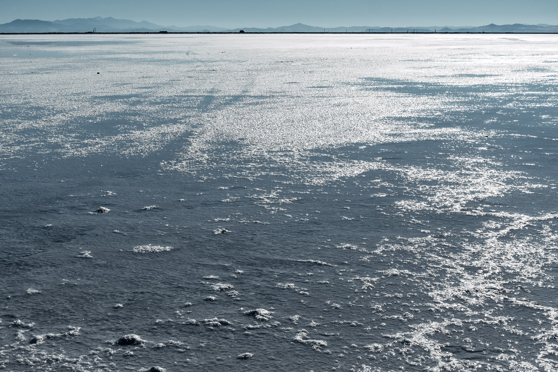 Water from a recent rain sits atop the expansive Bonneville Salt Flats, Utah.