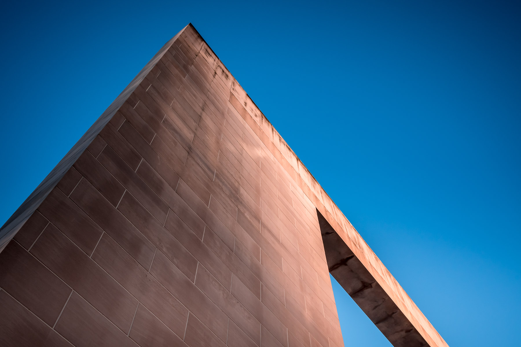 The Emery Reves Arch of Peace rises into the clear sky at the Meyerson Symphony Center in the Dallas Arts District.
