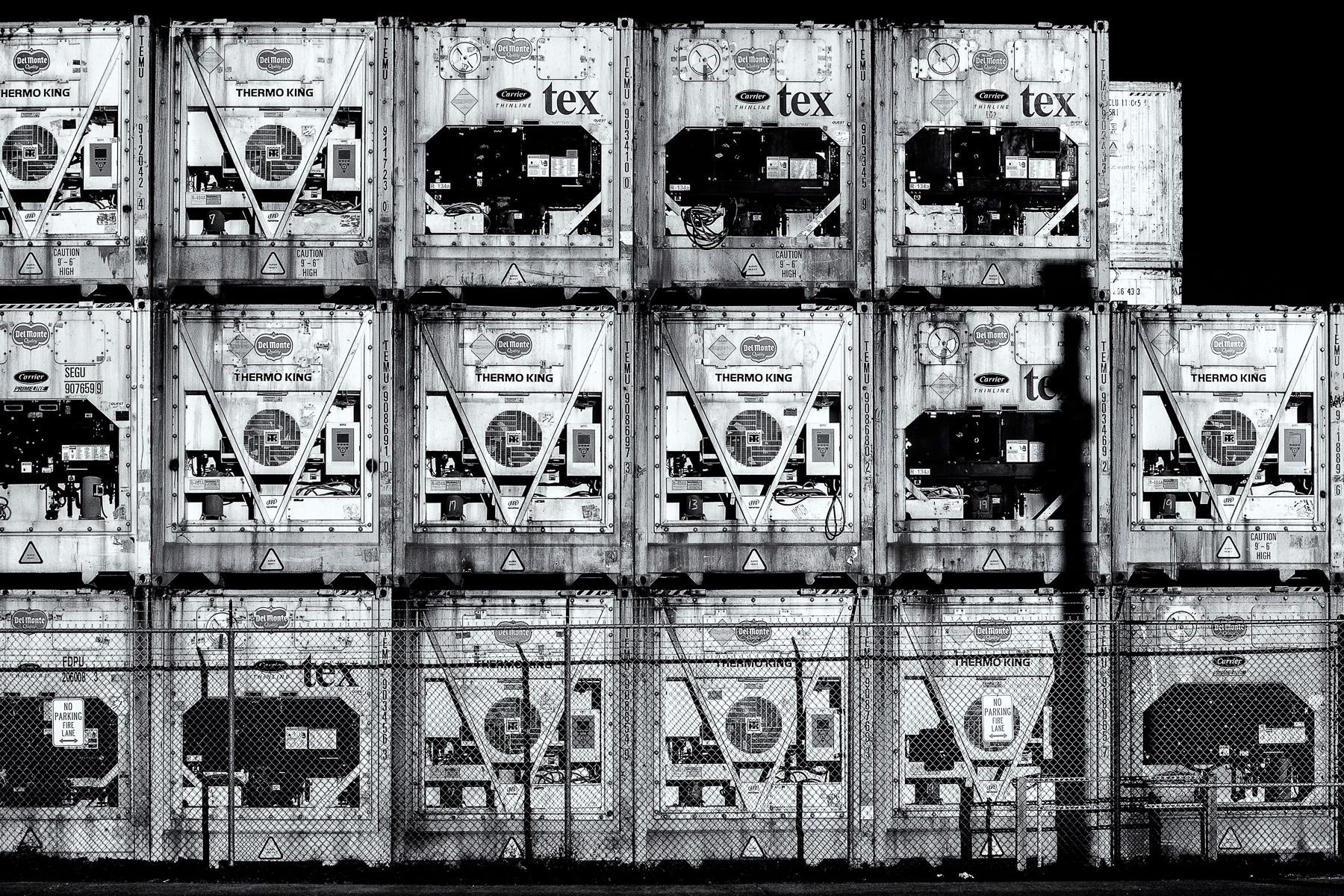 Refrigerated containers, or reefers, stacked in a container yard in Galveston, Texas.