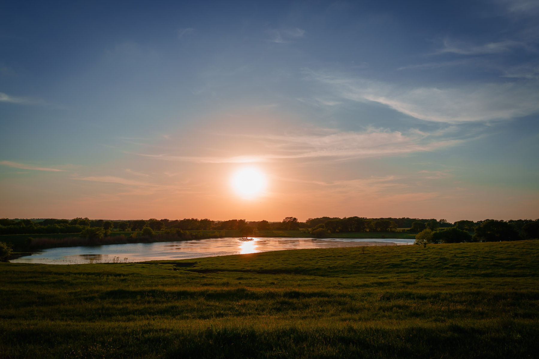 The sun sets on a small lake near the tiny North Texas town of Chambersville.