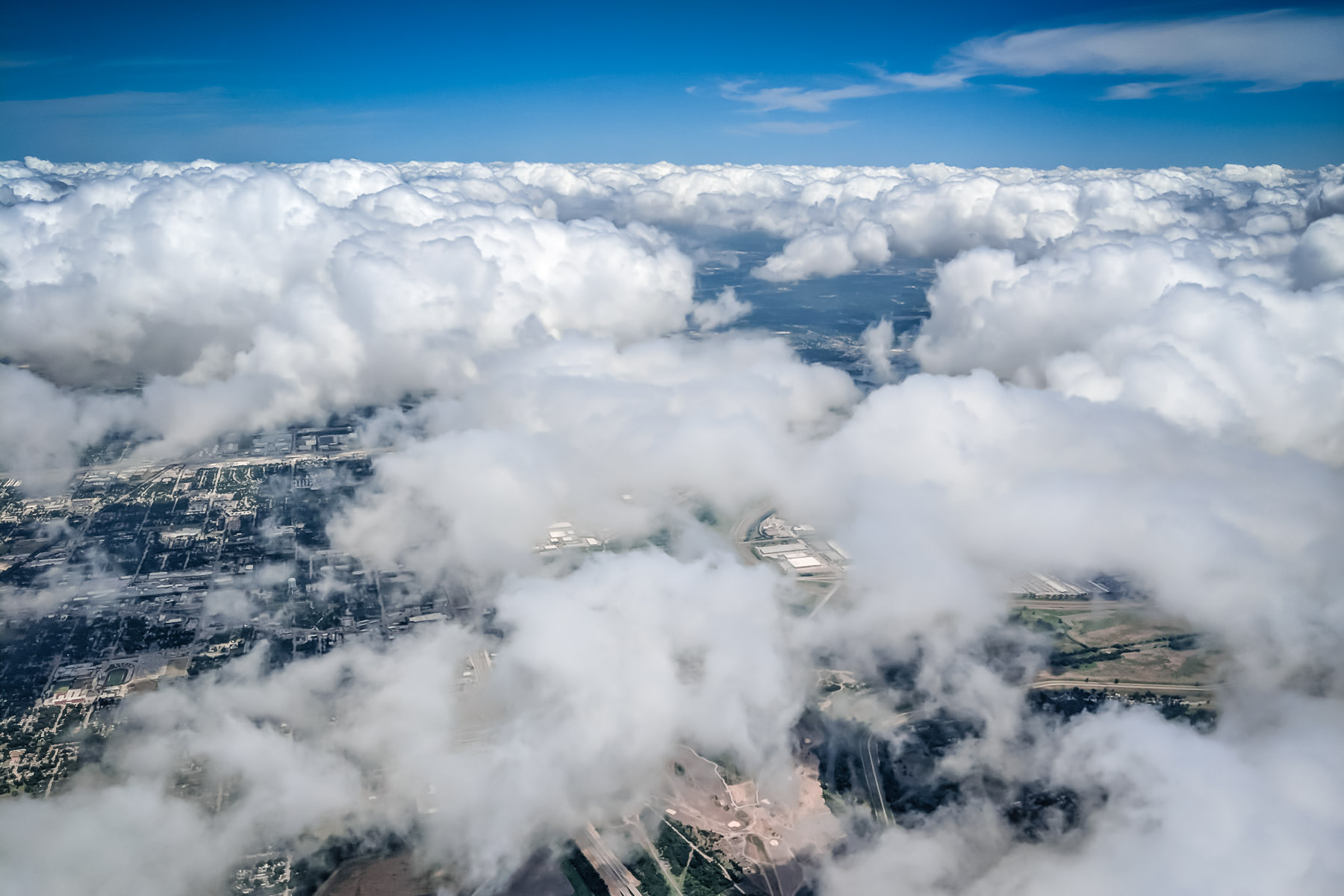 Flying over the cloudscape covering the outskirts of Dallas, Texas.