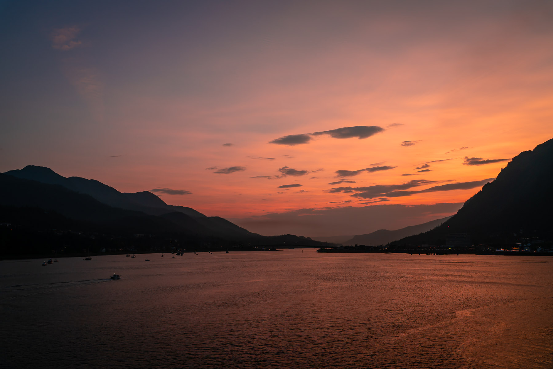 The sun sets on Juneau, Alaska, and the Gastineau Channel.