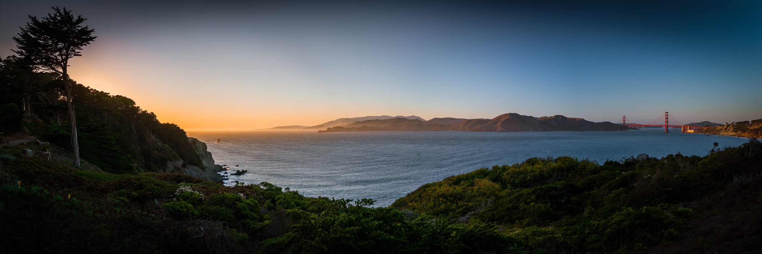The sun sets on the Golden Gate—the narrow strait between San Francisco and the Marin Headlands that connects San Francisco Bay with the Pacific Ocean.