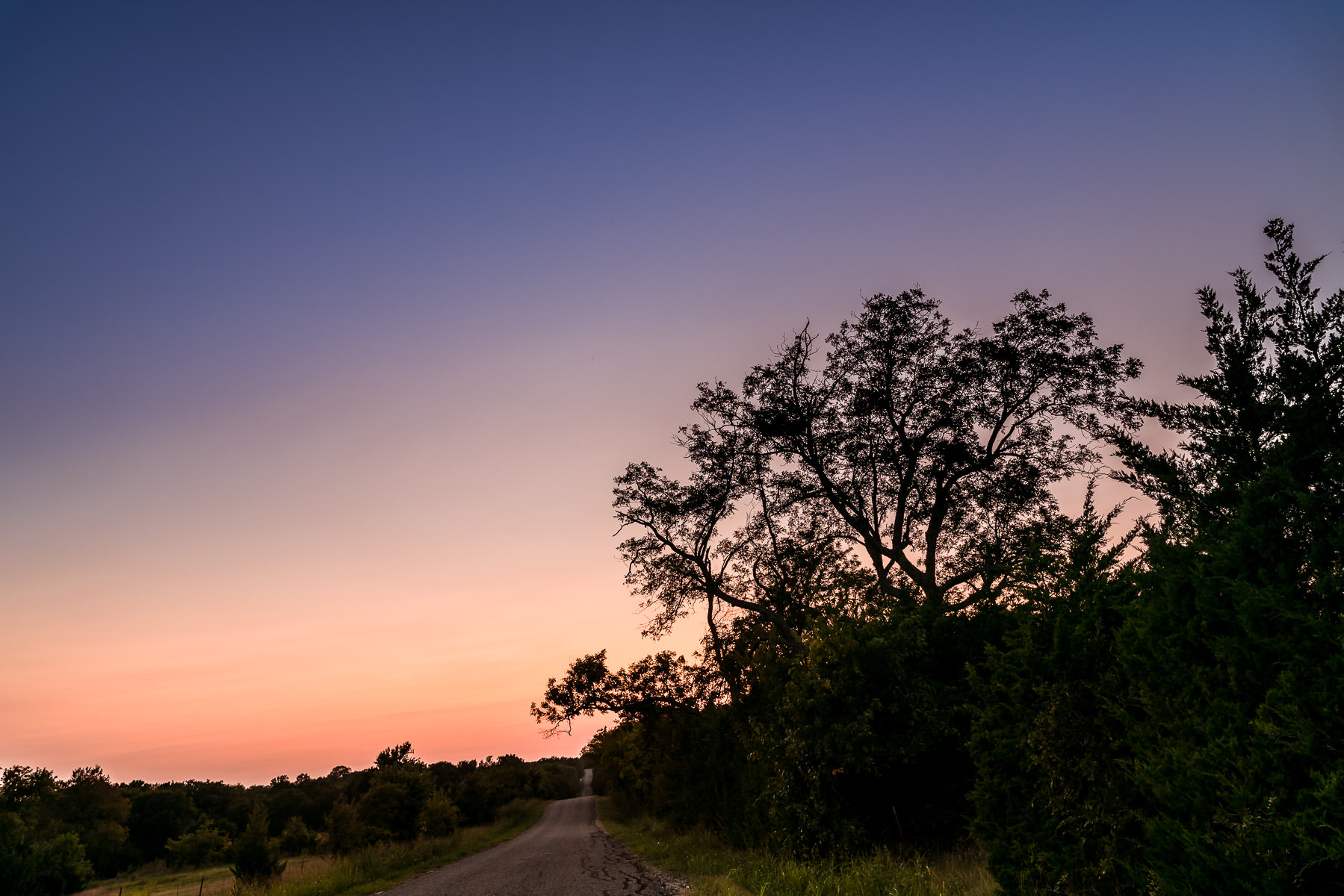 The sun sets on a backcountry road near Anna, Texas.