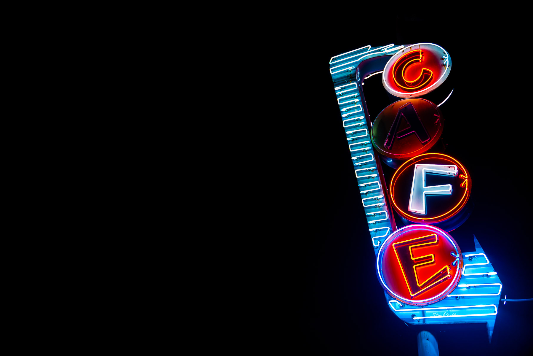 Bill Smith's Cafe's neon sign in the McKinney, Texas, night.
