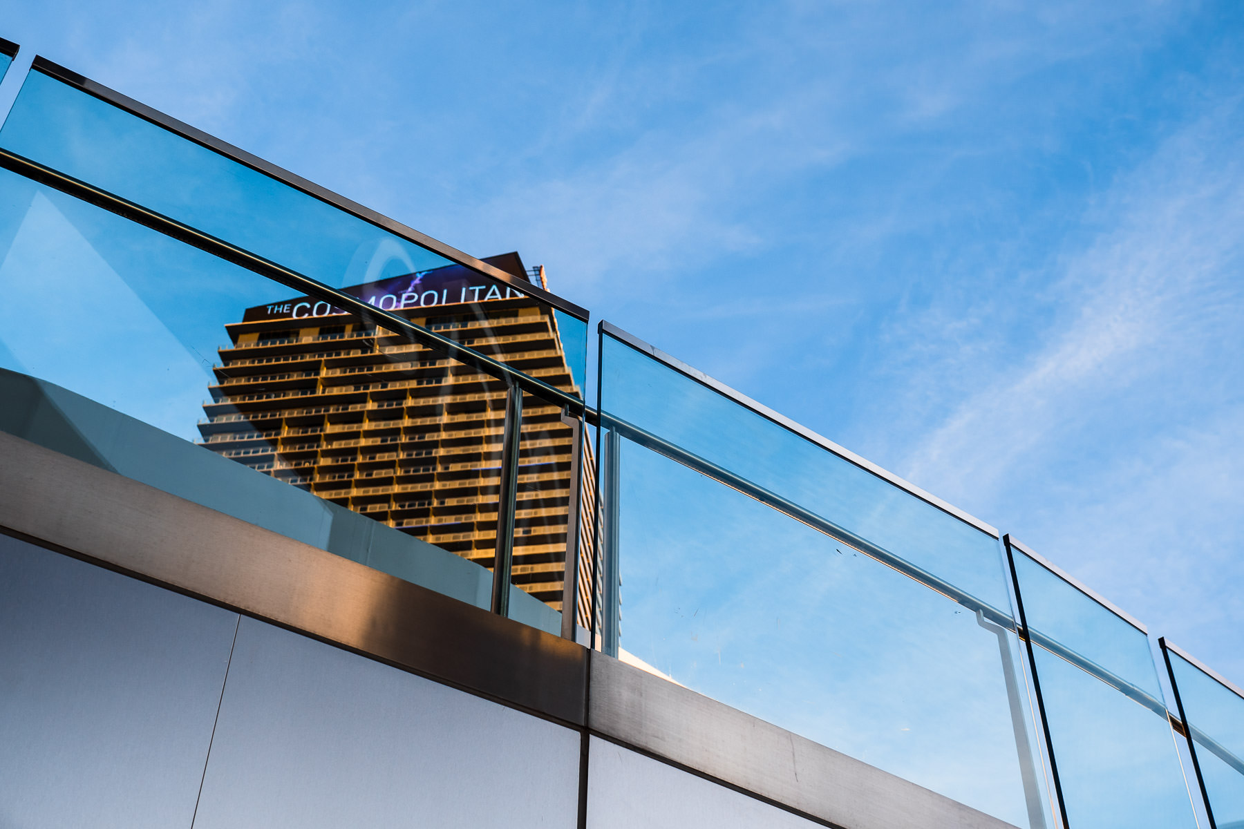 The Cosmopolitan of Las Vegas rises over an adjacent walkway along the Las Vegas Strip.