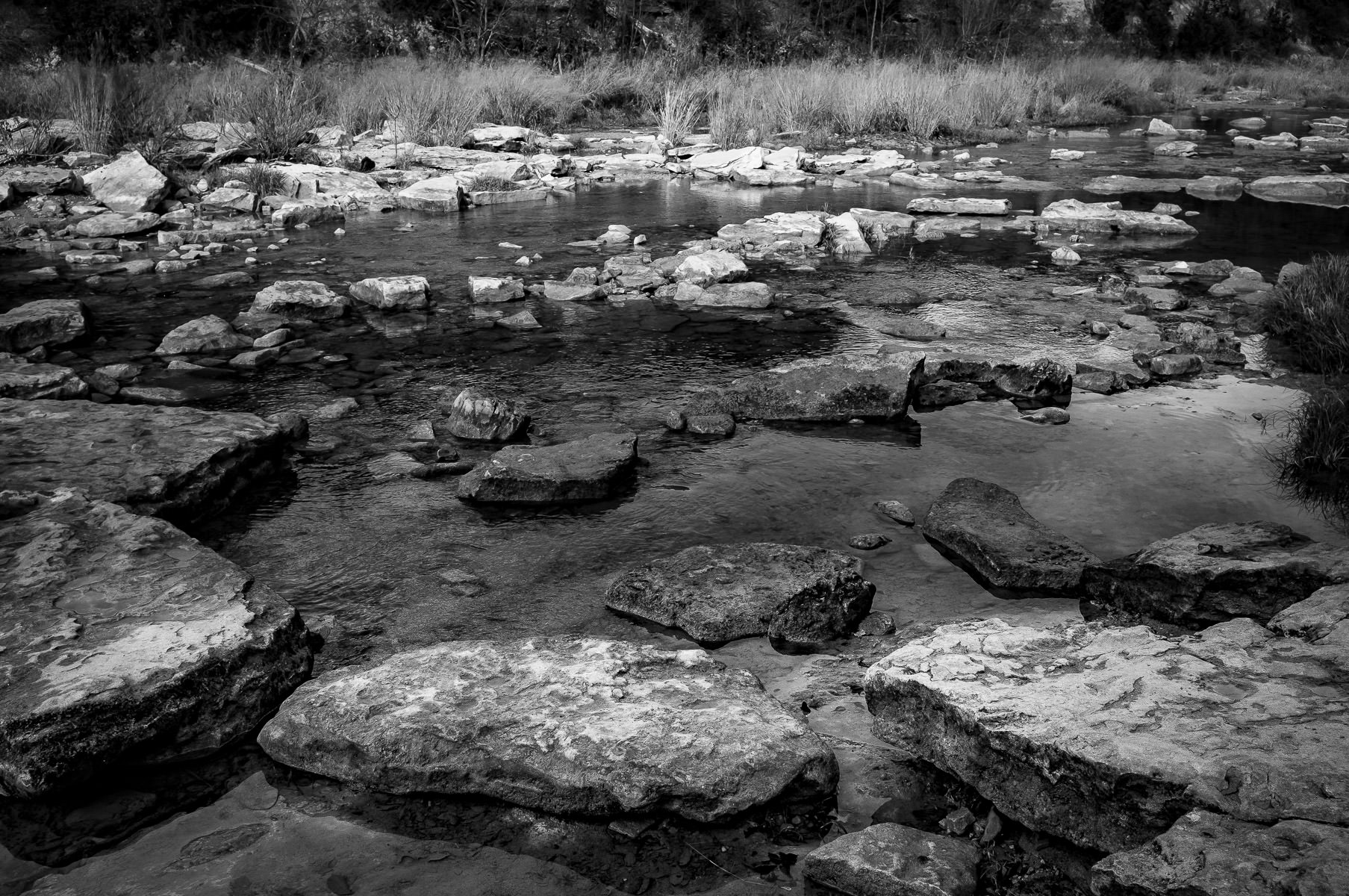The rocky riverbed of the Paluxy River in Texas' Dinosaur Valley State Park.