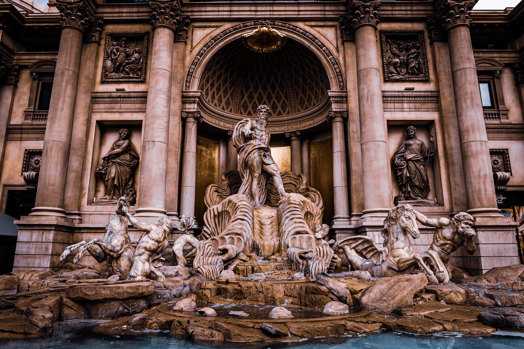 The Roman god of the sea, Neptune, stands in a replica of Rome's Trevi Fountain at Caesars Palace, Las Vegas.