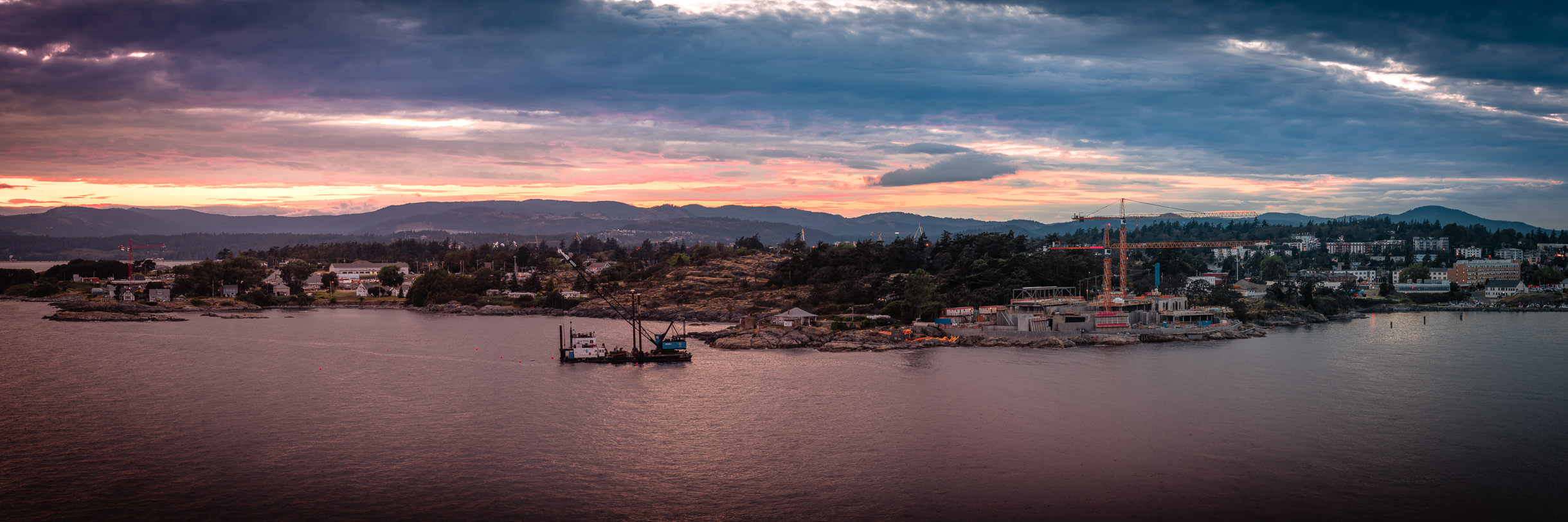 The sun sets on the West Bay district of Victoria, British Columbia.