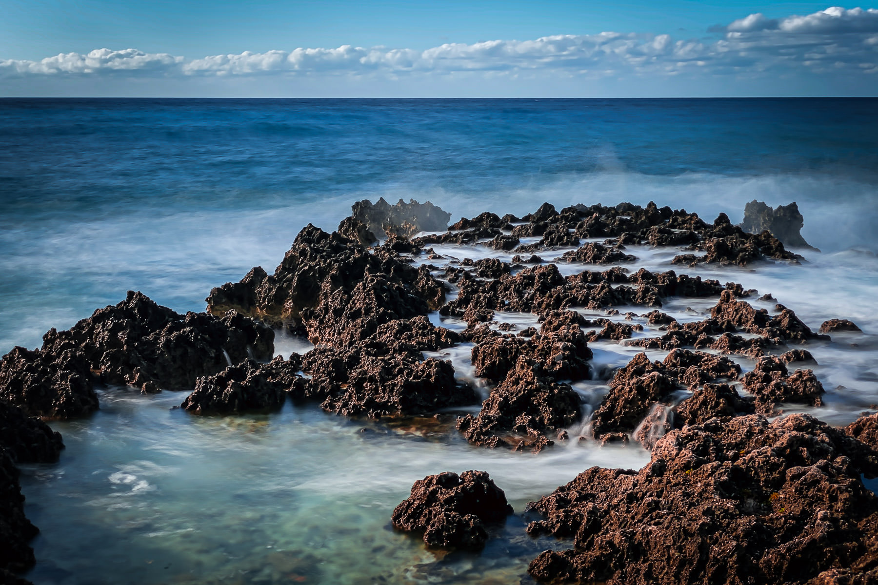 The rocky shore of a Grand Cayman beach.